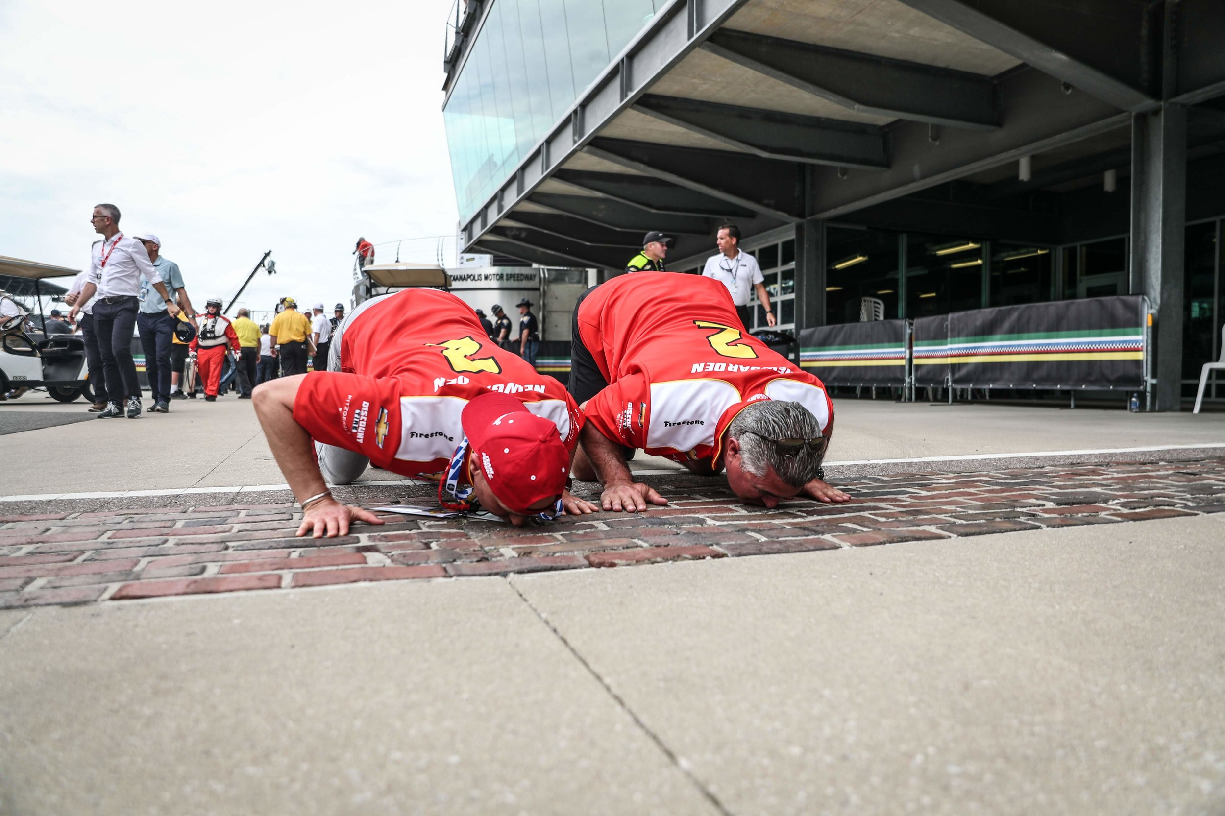 Kissing the bricks to celebrate the win.