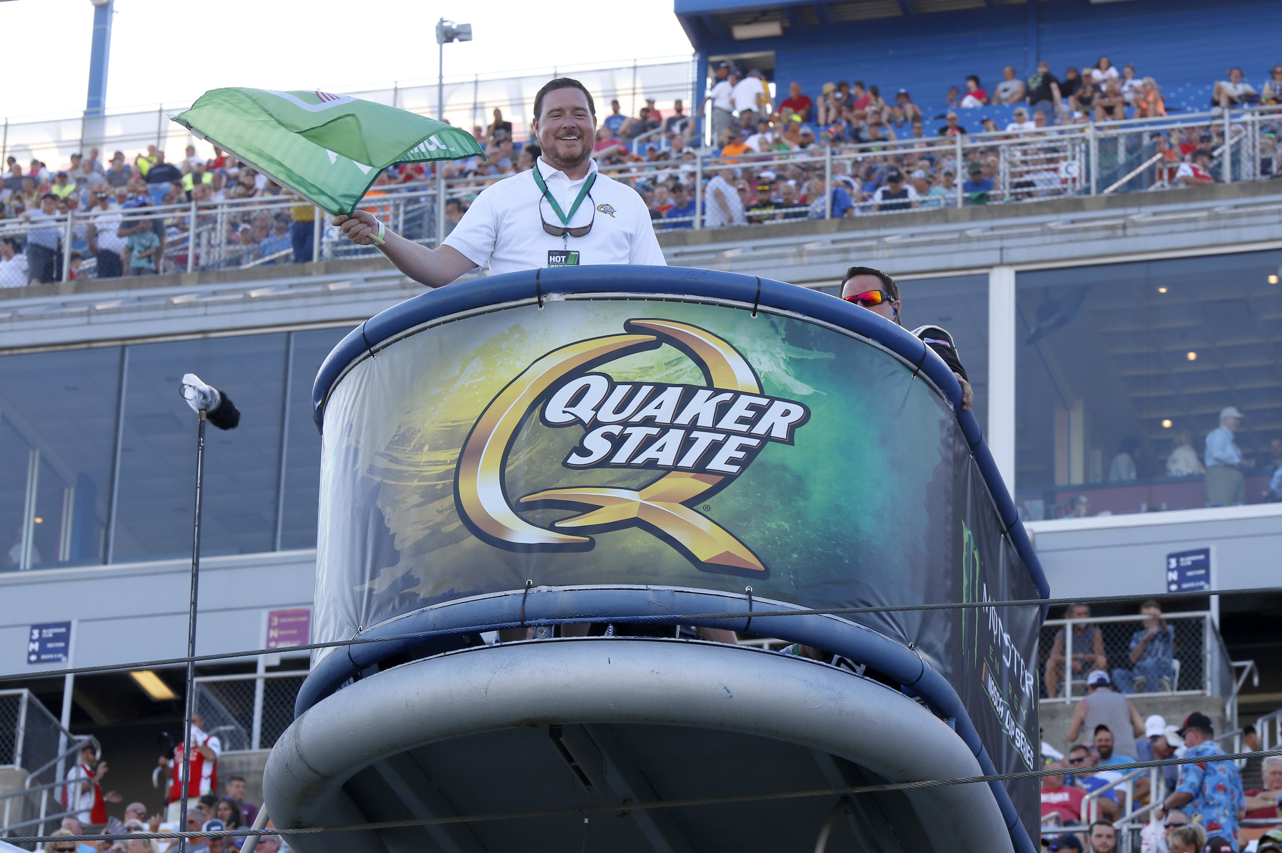 Starting the Quaker State 400 in style by waving the green flag.