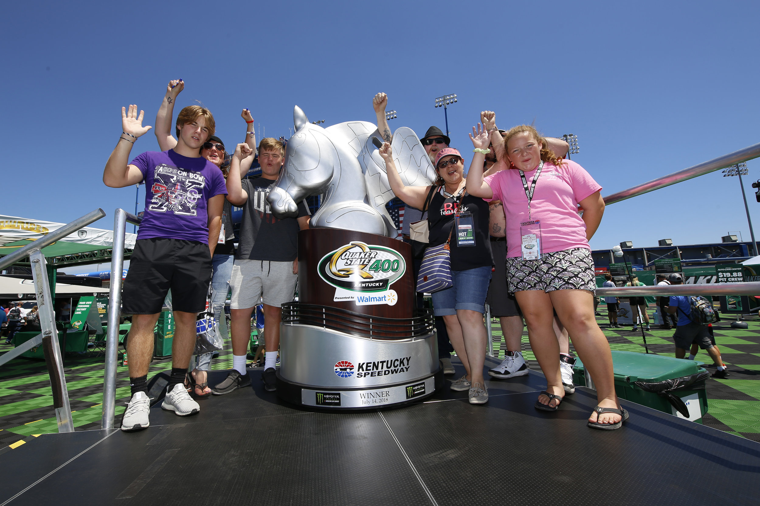LIVING TROPHY  The culmination of the fan experience was capturing   the winning moment, with a photo finish, on the larger-than-life replica of the Quaker State 400 trophy.
