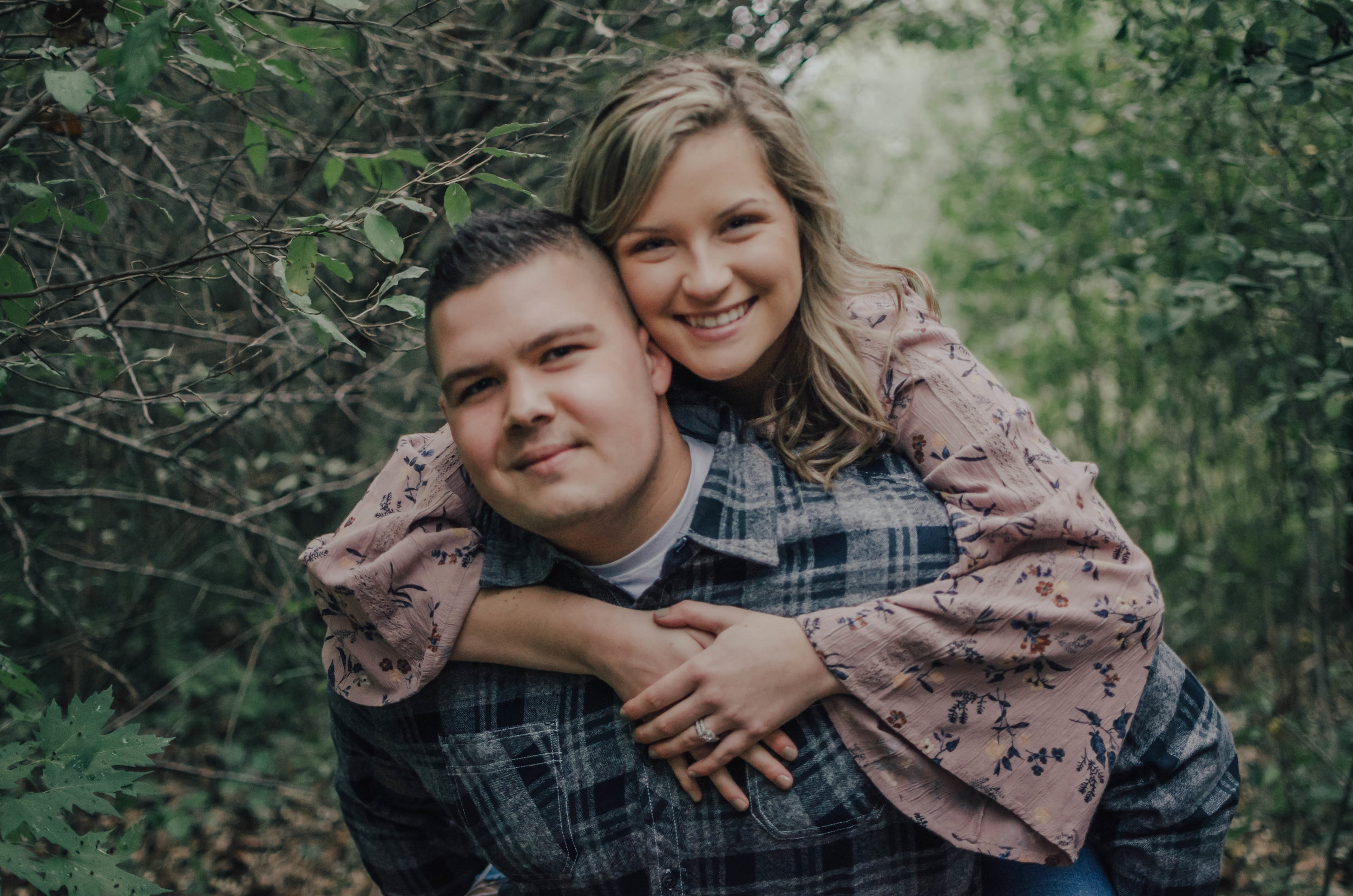 """Rustic & earthy… AMAZING - """"Our session was fun and laid back, the main focus was catching us in our natural form. I liked that you let us be ourselves. You were fun to work with and did whatever needed to get our pictures perfect (like standing in the rain).""""- Courtney & Logan"""