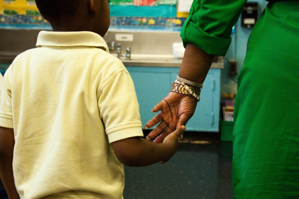 """The other afternoon I found myself walking beside a group of ebullient kindergartners. Two sweet girls showed me their artwork as they headed back to their classroom from art. The fire alarm went off just as I was about to wave goodbye and head back to the library. Instead, I followed the class hoping to help the young teacher shepherd her students out the door, but she had everything well in hand and did not need my help. Once outside, she dutifully counted every little head and gave me a look of relief…how well I know that feeling. It was then that she noticed unbeknownst to me that a little girl standing near me was in distress. She supported the child and asked…""""Are you ok? Are you dizzy?"""" Not a millisecond later another kindergarten teacher came over, offered her help, and then ran full tilt back to the classroom to get the needed supplies from the child's backpack. The child never once whimpered or cried, because she knew she was in her teacher's safe hands.  Once everyone was safely in the classroom and a medical crisis was averted, I marveled at how these two young teachers calmly worked together. I was reminded that teachers are the foot soldiers of our education system…they do the heavy lifting, the day to day care, and yet are also charged with the often onerous & unrealistic academic demands of state policy makers, think tank specialists, and some uninformed state legislators…none of whom would have a clue how to move a group of 5 year old children safely out of a building in a fire drill or deal so expertly with a young child's distress. If you haven't yet thanked a teacher for all they did this year…please do. The school year is almost over, and we desperately need them to come back next year."""