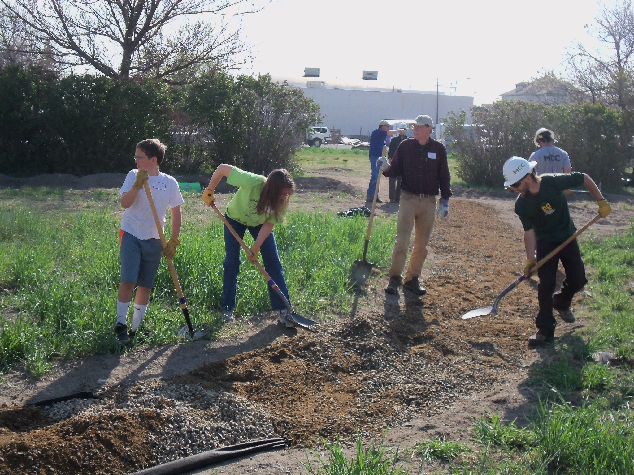 Volunteers help to construct paths throughout the garden.