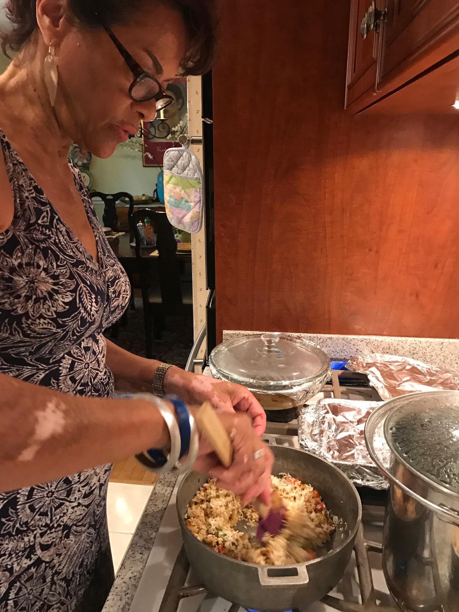 Ita stirring the rice and Sazon together