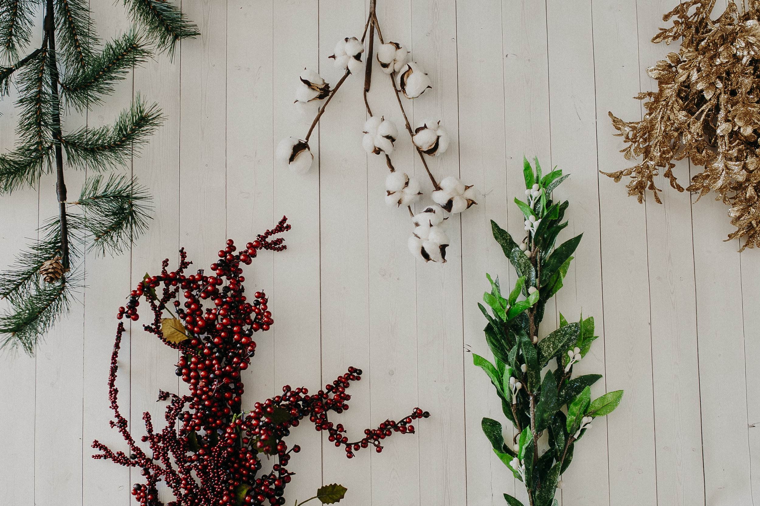 Step 1 -   Using your wire cutters, snip off the pieces of garland you wish to use in your winter sprig