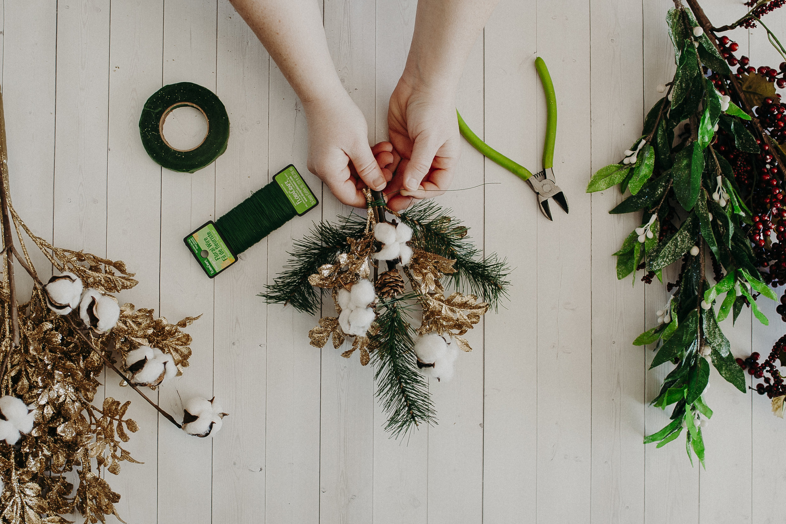 Step 2 -   Arrange your garland pieces to create your perfect sprig, then secure them with floral wire