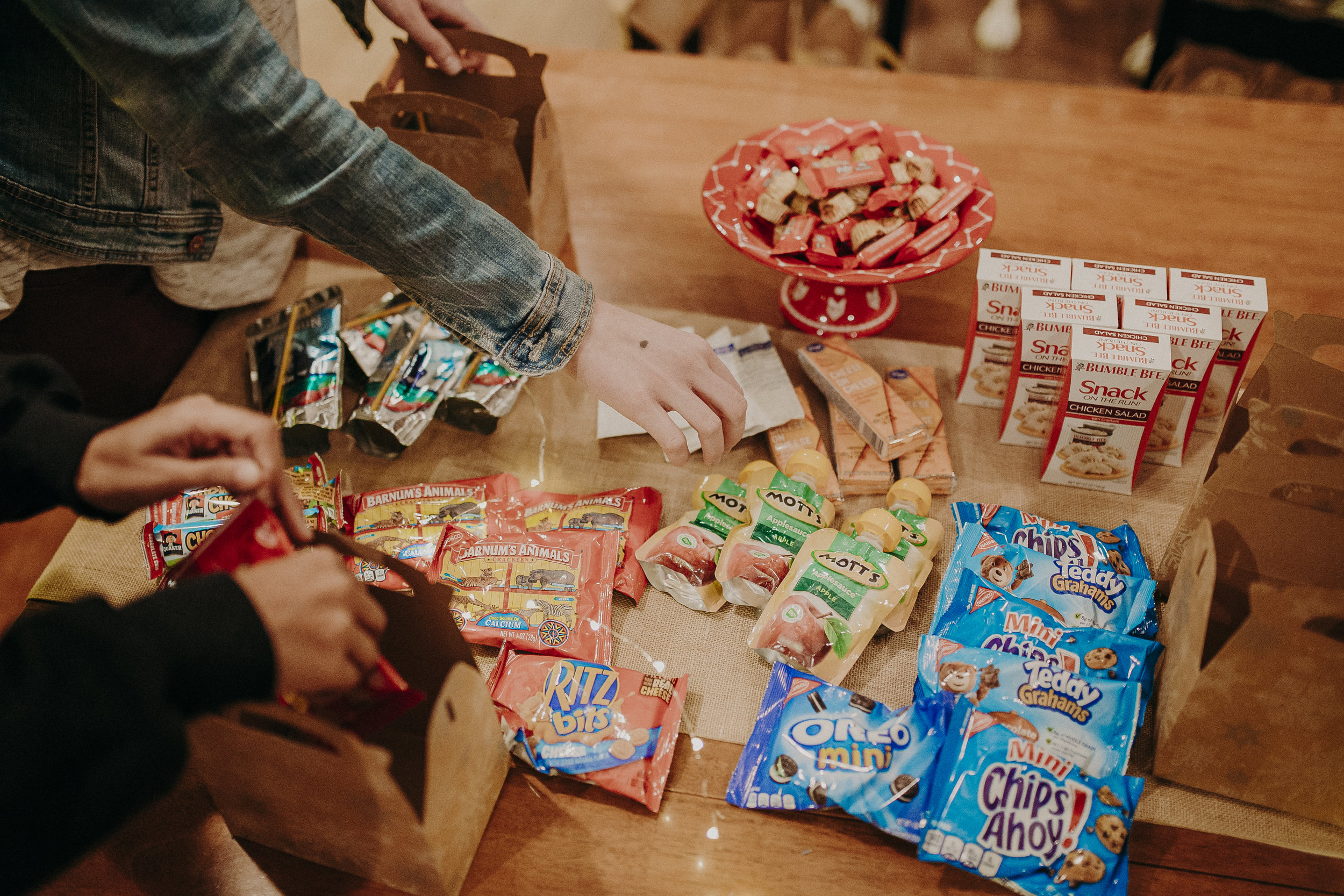 Once the boxes were all assembled, it was time to fill them. I tried to get a variety of foods, to satisfy any craving. From chocolates, to chicken salad with crackers, to applesauce. I hoped there was something for everyone.