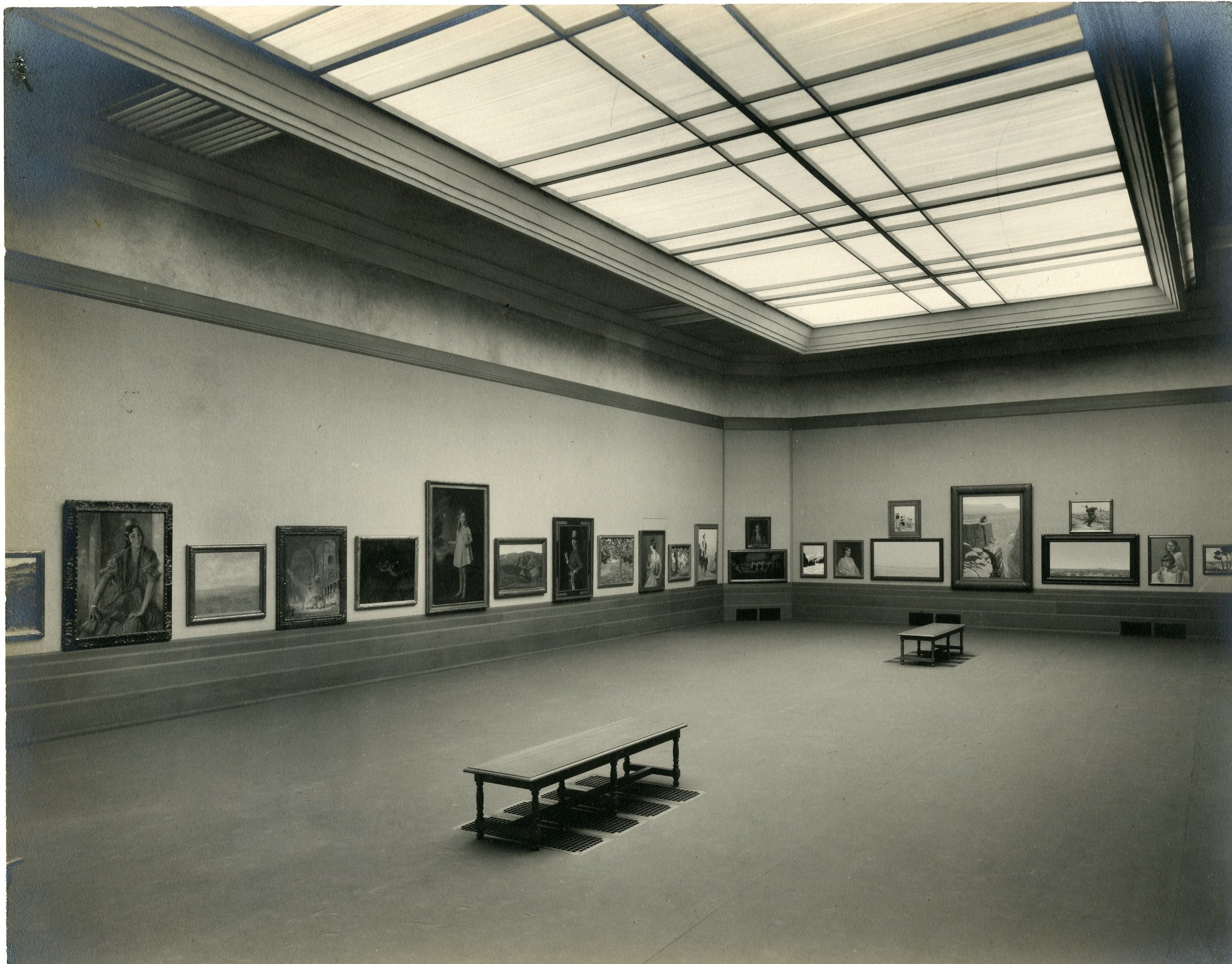 Faulkner Gallery exhibit at 1930 grand opening. Third full picture from far left: Likely a Colin Campbell Cooper's Interior of St. Mark's Cathedral. Big vertical painting at end of room is an over-the-top Grand Canyon by Fernand Lungren. Photoimage courtesy of Santa Barbara Public Library.