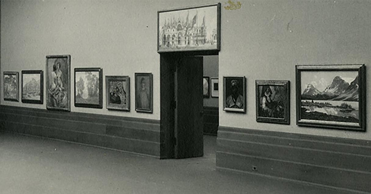 Antonia Greene's Ethiopian lady portrait study in 1930 Faulkner Gallery opening exhibit. Portrait hangs to right of facing door.