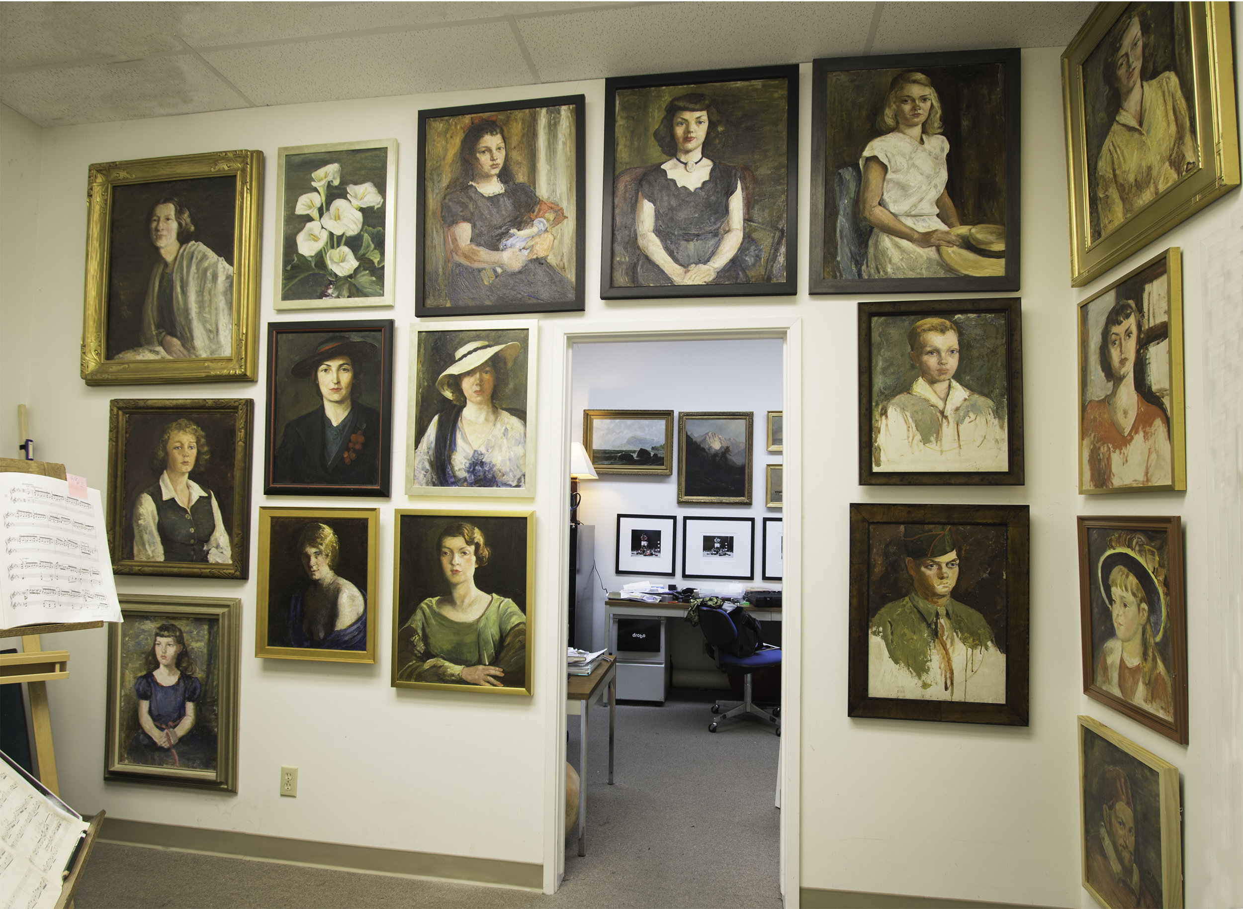 My office wall is holding up all the Antonia Greene paintings I own. These were painted between the 1920's and the 1950's.