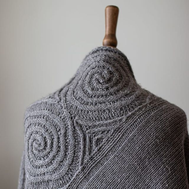 Today I'm re-releasing my Newgrange shawl pattern as a single-pattern download. Newgrange was originally published in Stolen Stitches' Echoes of Heather and Stone (2018). This modularly-constructed triangular shawl makes use of cables, slipped stitches and short rows to evoke the carved double-spirals found in Neolithic rock art. Numerous spiral carvings decorate the passage tomb of Newgrange, in Ireland, which was designed and built with an orientation towards the winter solstice. Similar carvings are found across Western Europe, at sites such as Achnabreck in Scotland and Gavrinis in Brittany.  http://ravelry.com/patterns/library/newgrange