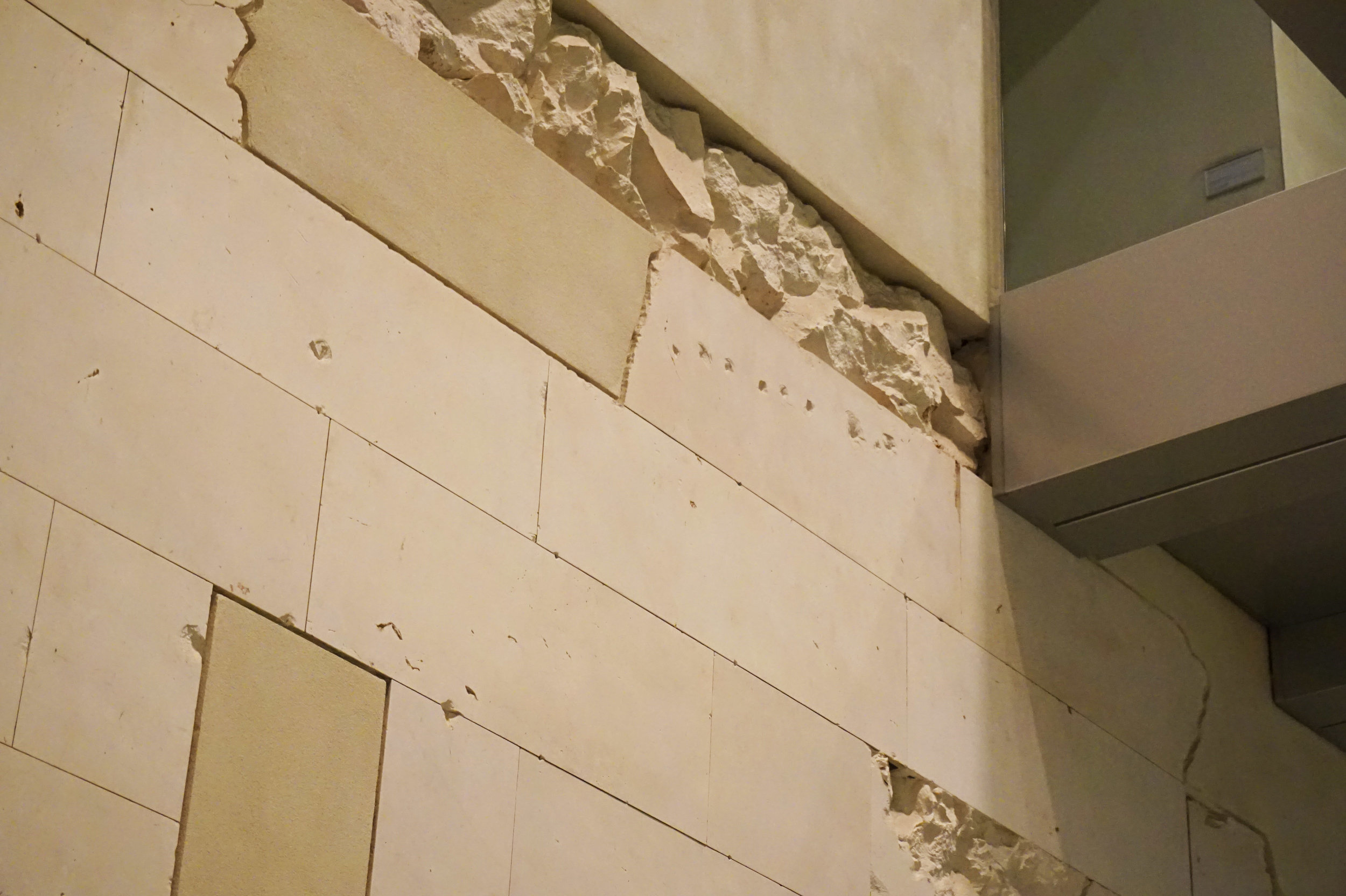 The holes on the Reichstag Building's walls are actual bullet marks, preserved to be a reminder of its painful past