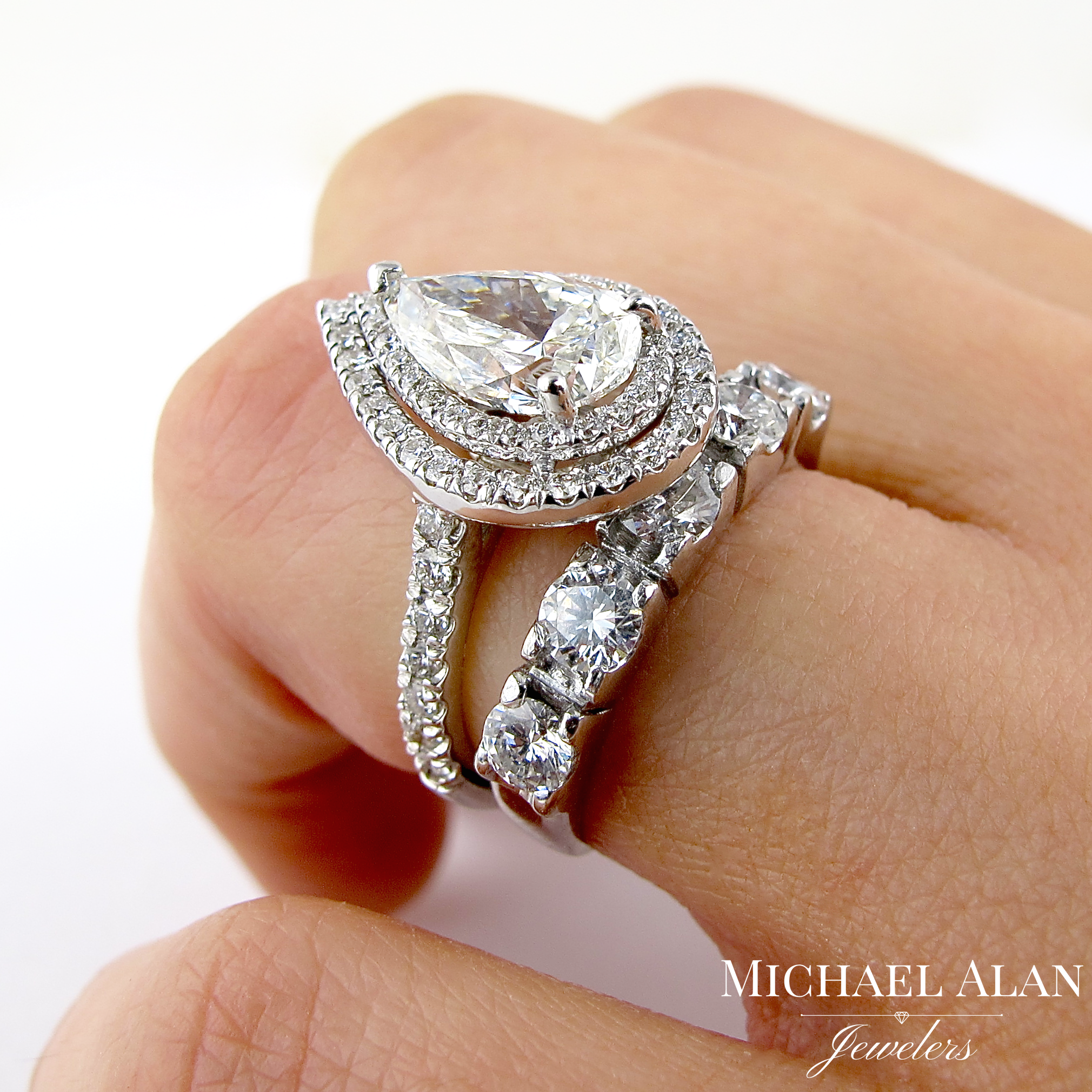 This wedding band creates a loud and robust contrast with the engagement ring by having larger diamonds and a wider band.