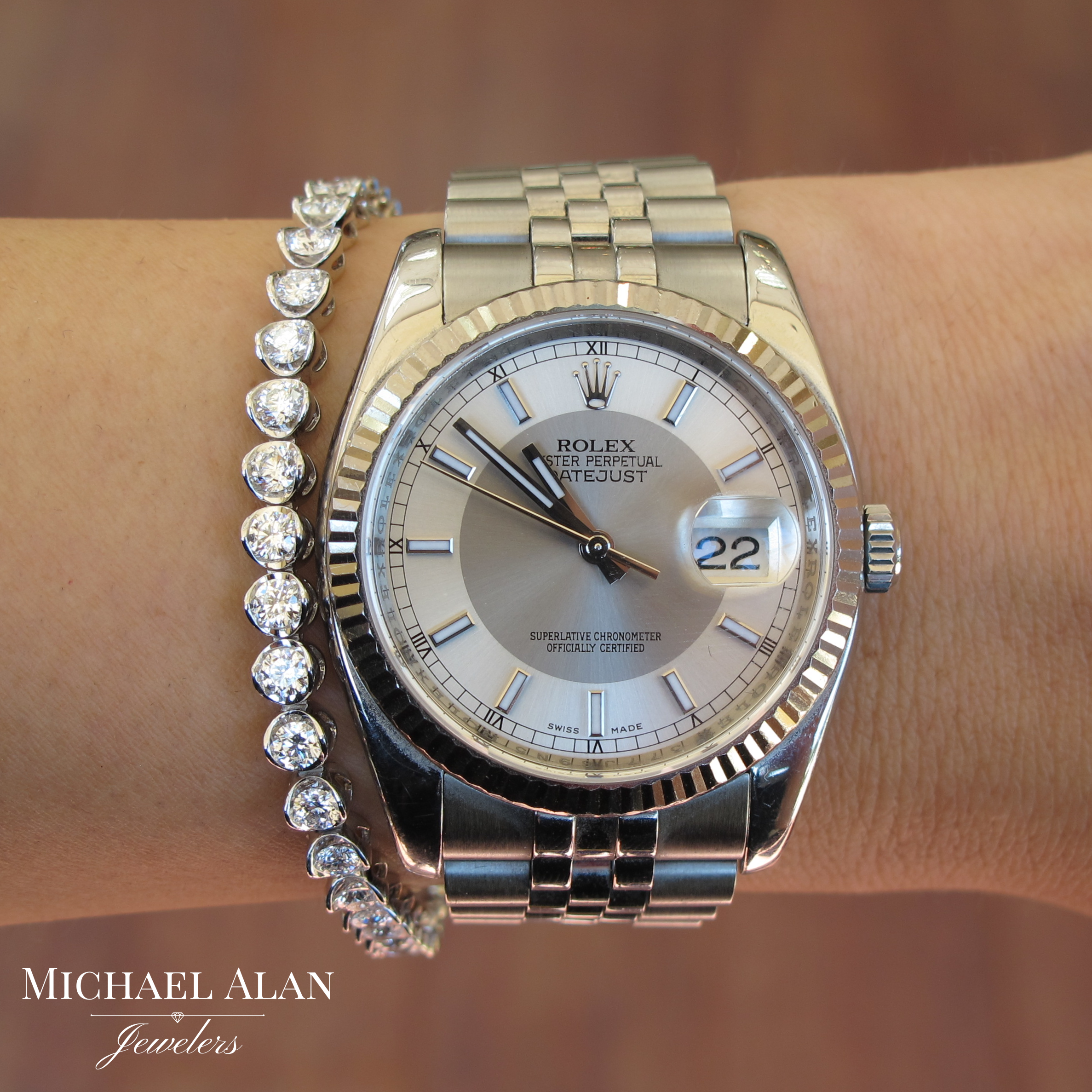 18K white gold tennis bracelet with 40 round brilliant cut diamonds at 4.86 carat total weight.