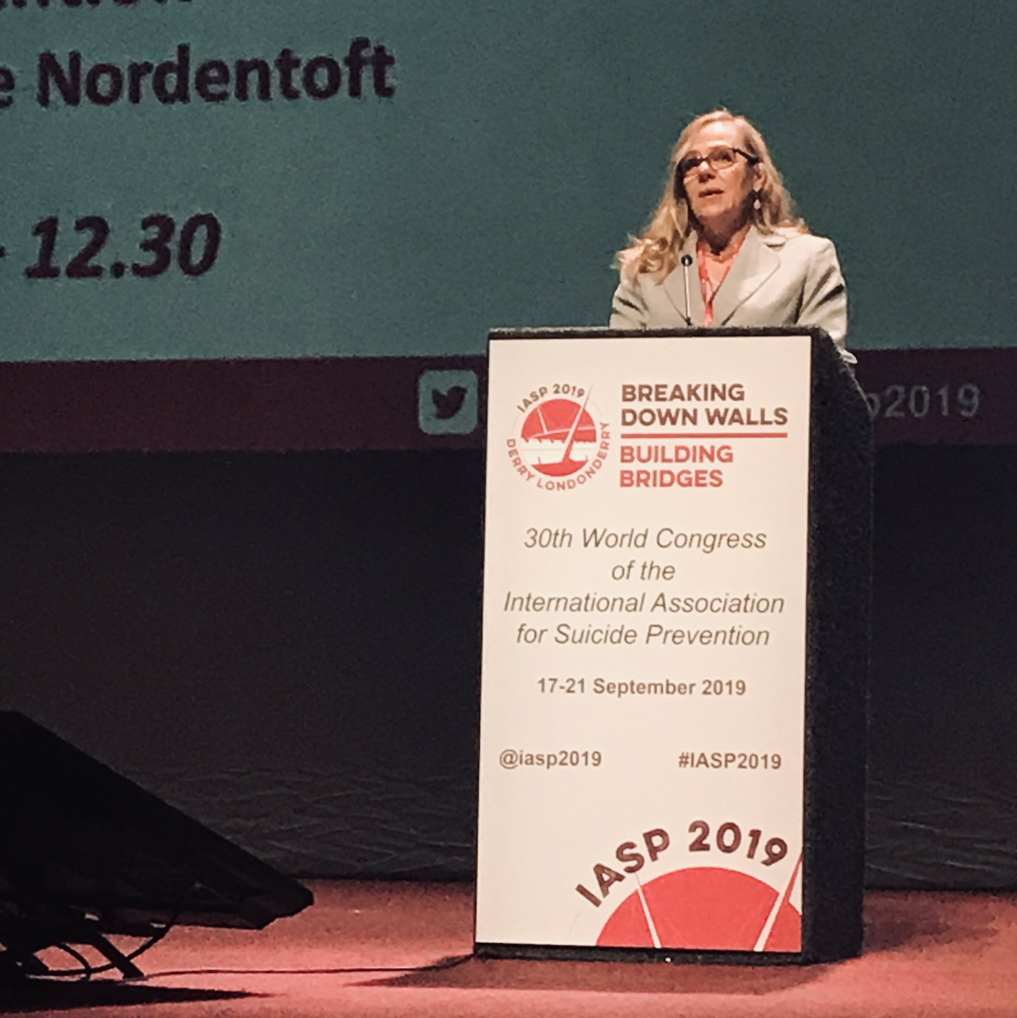 IASP2019 Sally at podium.jpg