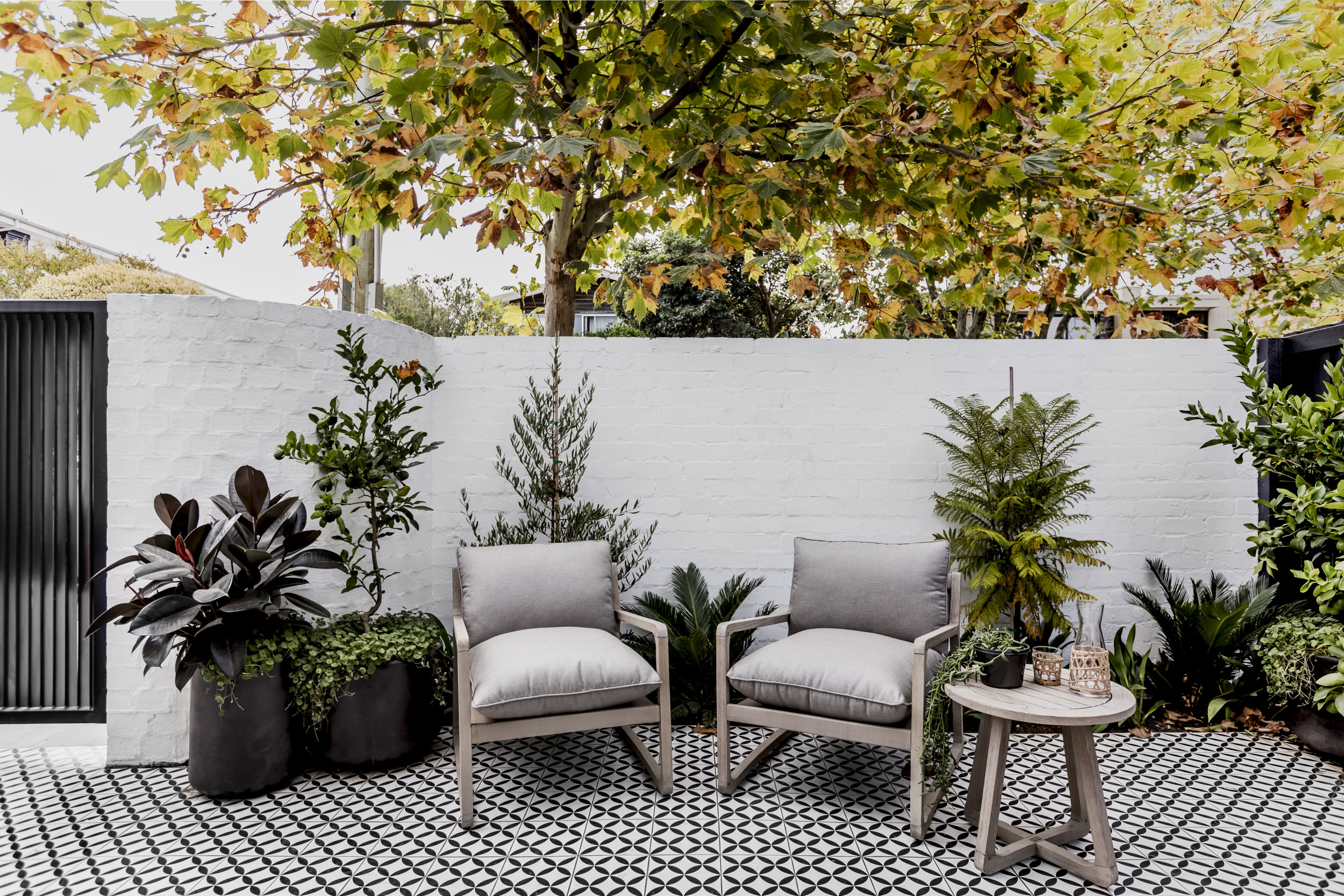 The courtyard, with its beautiful and graphic floor tiles. Photo -  Maegan Brown .