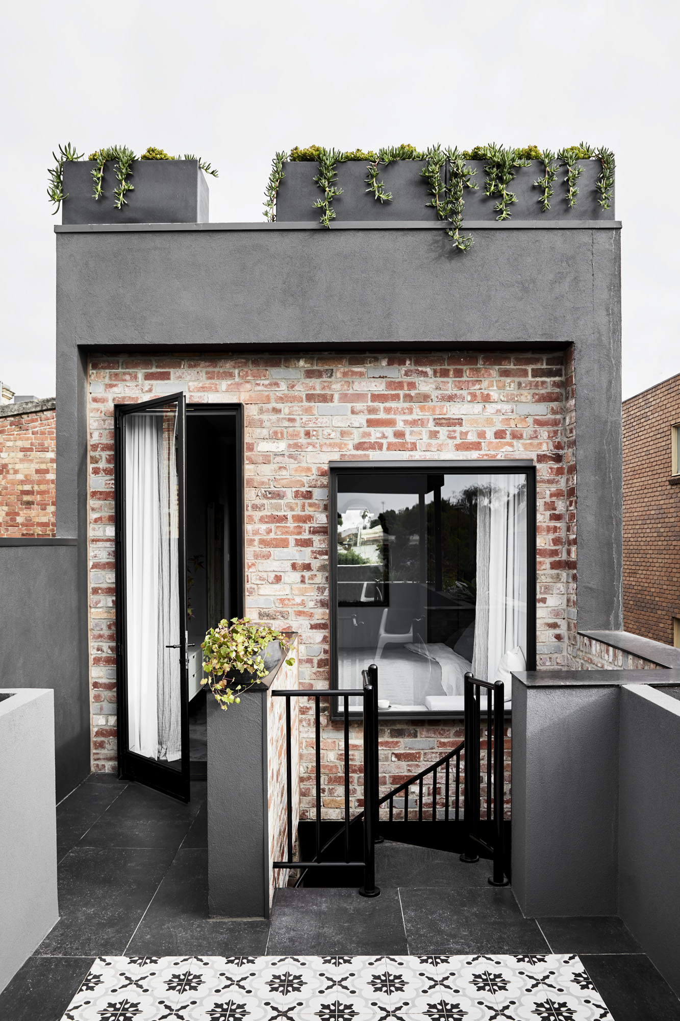 The exterior of the Fitzroy home of interior designer  Kate Challis  and family. Photo –  Sharyn Cairns .