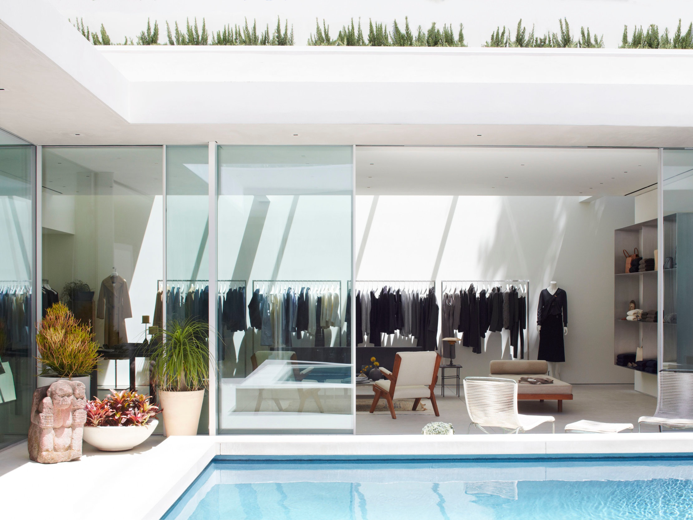 The Row - This sparse and elegantly minimal space is the perfect example of showing restraint in an interior. Bathed in Californian sunlight, the space features European furniture and vintage jewellery alongside the brands clothing line. Complete with a recessed pool in the courtyard, this is one retail experience which will be hard to leave.Find The Row8440 Melrose Place, Los Angeles, California 90069, United States
