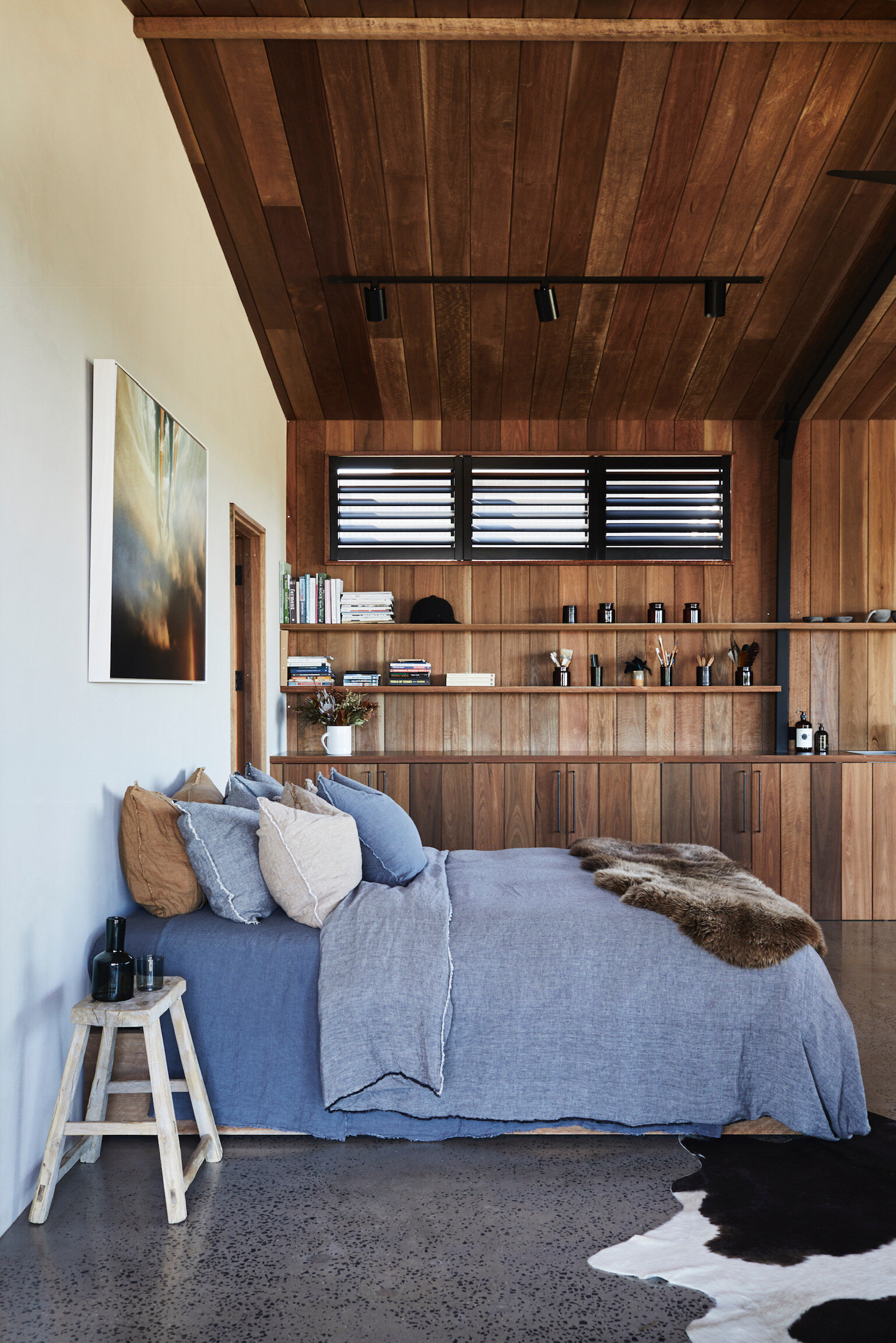 Textural heaven with timber, concrete and linen dominating one of the bedroom spaces. Photo - Alicia Taylor Photography.