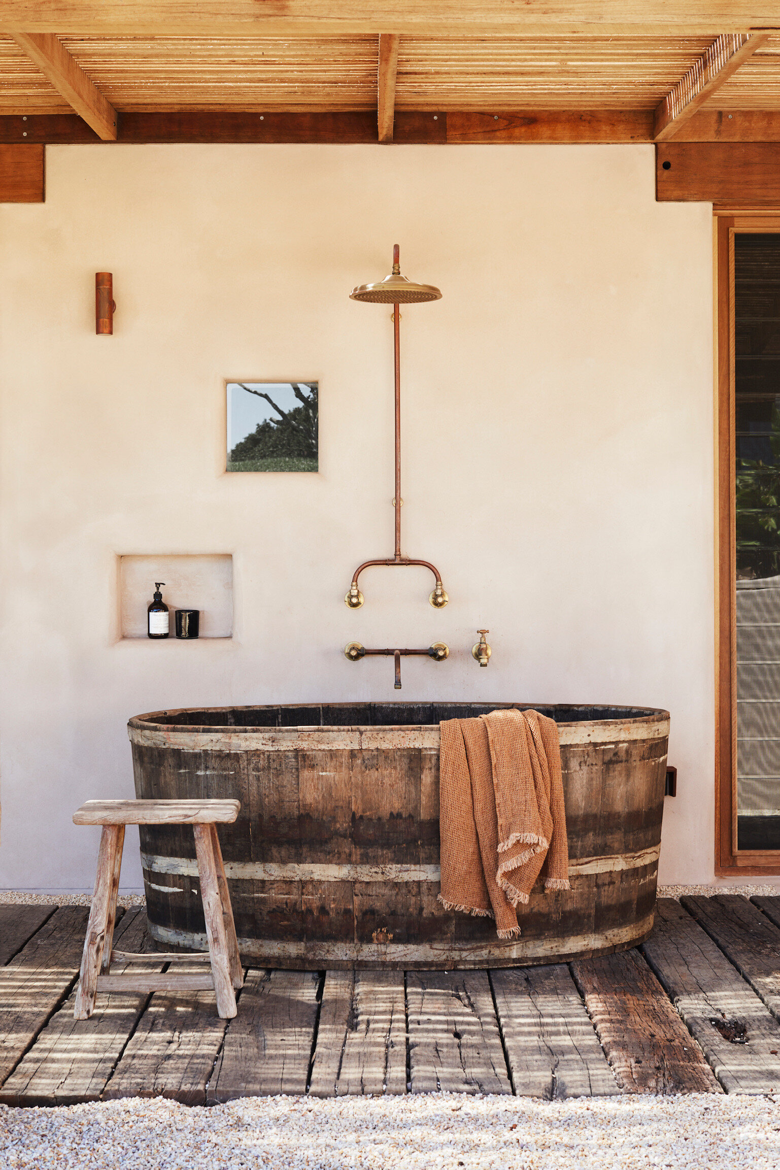 At The Range, the rustic timber outdoor bathtub takes pride of place on the outdoor deck. Photo - Alicia Taylor Photography.