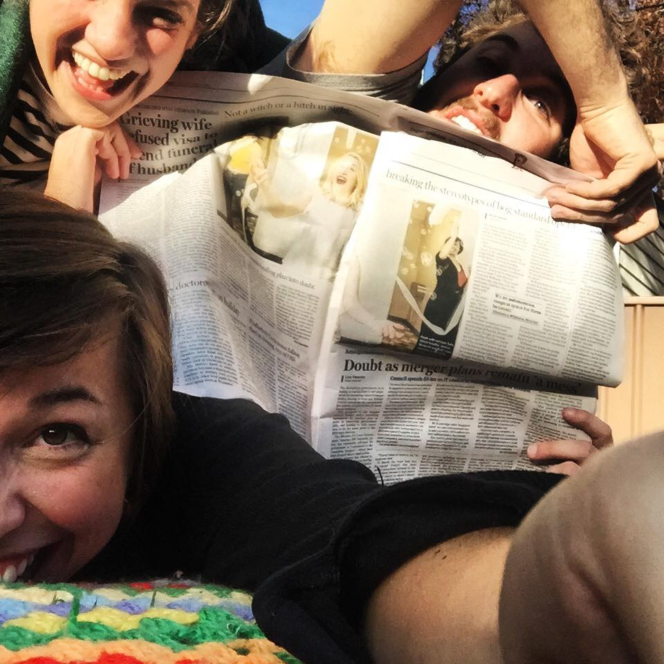 Old showmates/new housmates Thomas De Angelis, Britt Lewis and Sally Alrich-Smythe retreat to a picnic blanket in their backyard to celebrate an article on Chamber Pot Opera featured in The Daily Telegraph last week.