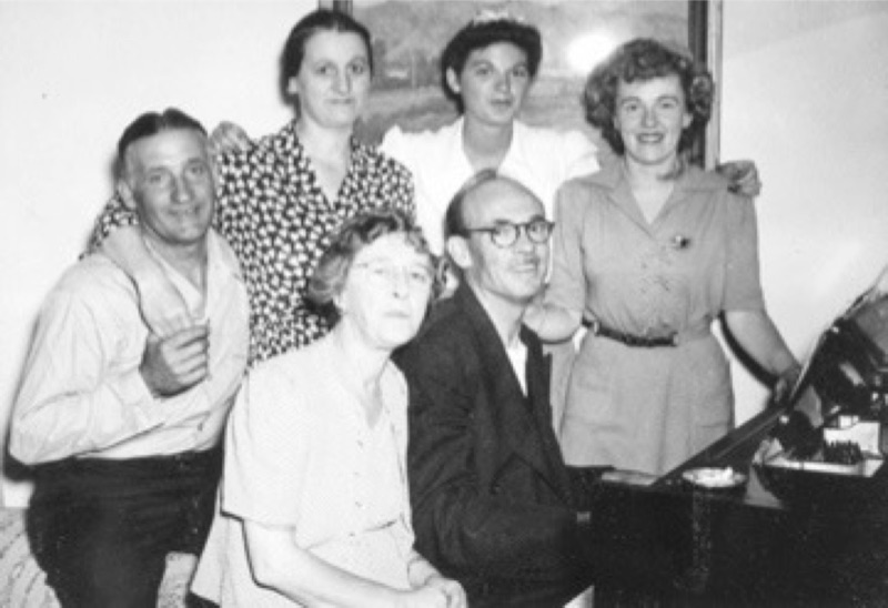 Homebodies of NorCal: (seated) My grandma Gertrude Capurro, grandpa Alfred McKnew at the piano, and my mom Marijane McKnew standing to his right. Behind are best family friends, Fred, Velma and Jane Tavoni.