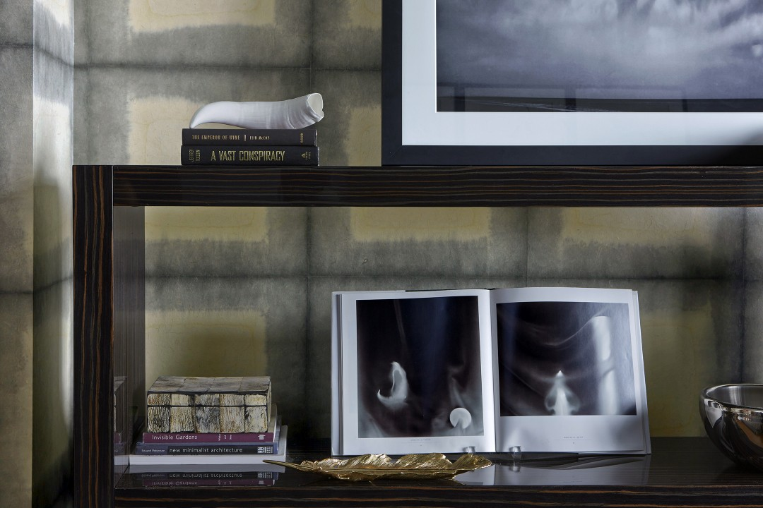 Wallpaper from Kyoto hand-made from mulberry bark contrasts with the Italian macassar bookcase.