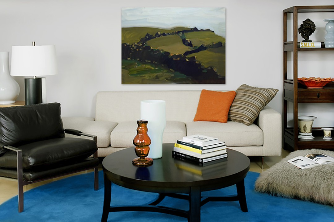 Balancing texture and scale of the furnishings allows an outspoken blue rug to anchor rather than overwhelm the setting.