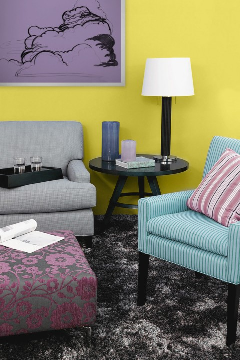 A plush, neutral rug sounds a bass note underneath a playful fanfare of patterns and colors.