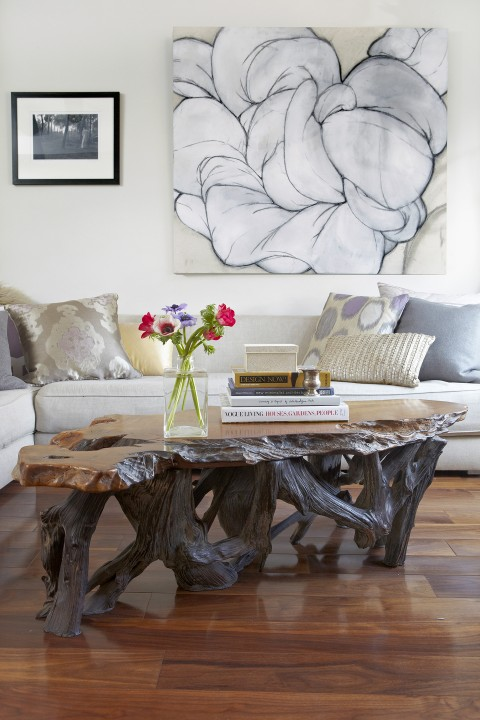 The 1970s coffee table is reminiscent of organic wood sculpture from Bali.