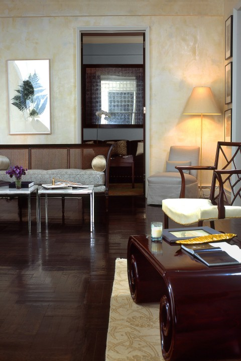The living room harmonizes eclectic styles of wide-ranging times and places.