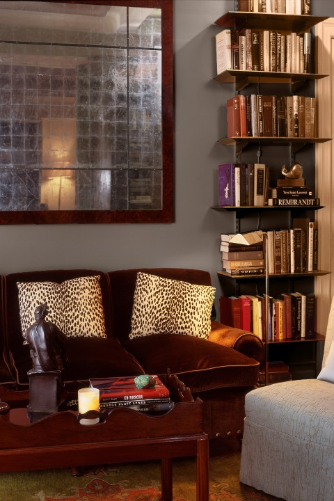 Custom shelving showcases the large library of a voracious reader.