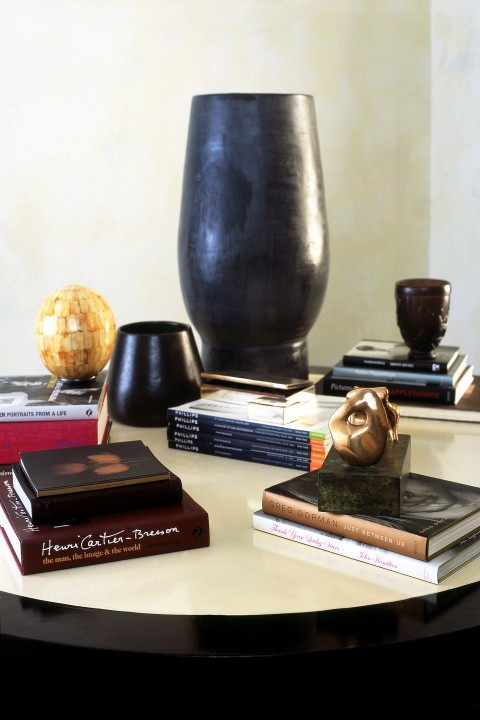 A Henry Moore maquette takes pride of place on this scholar's table filled with art books and novels.