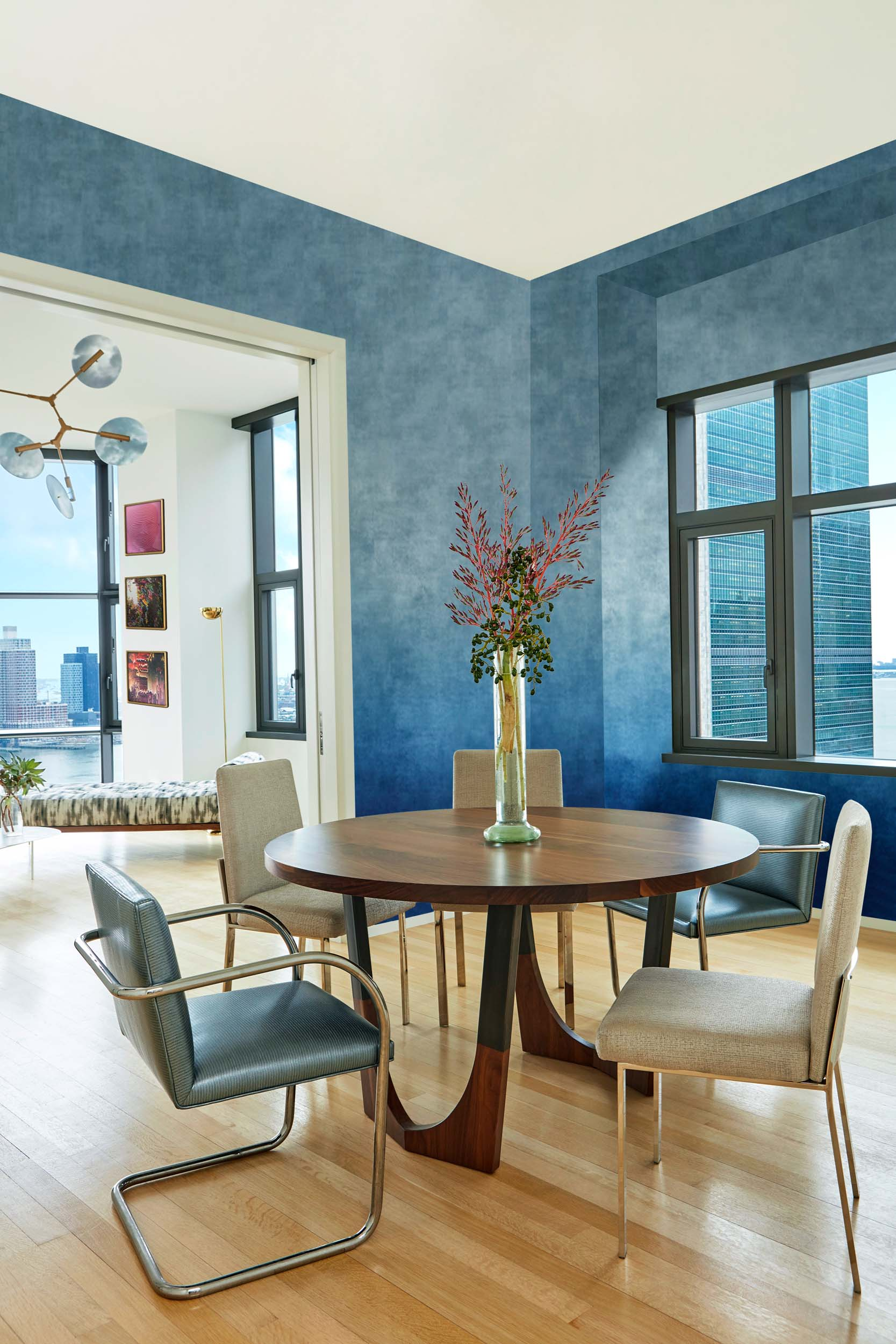 turquoise blue painted living roomwith wooden round table for five