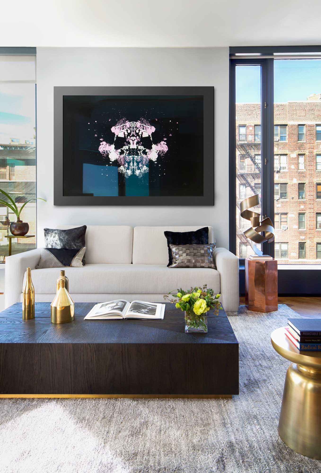 Modern design living room with gray carpet, large wooden center table, wide windows overlooking the city