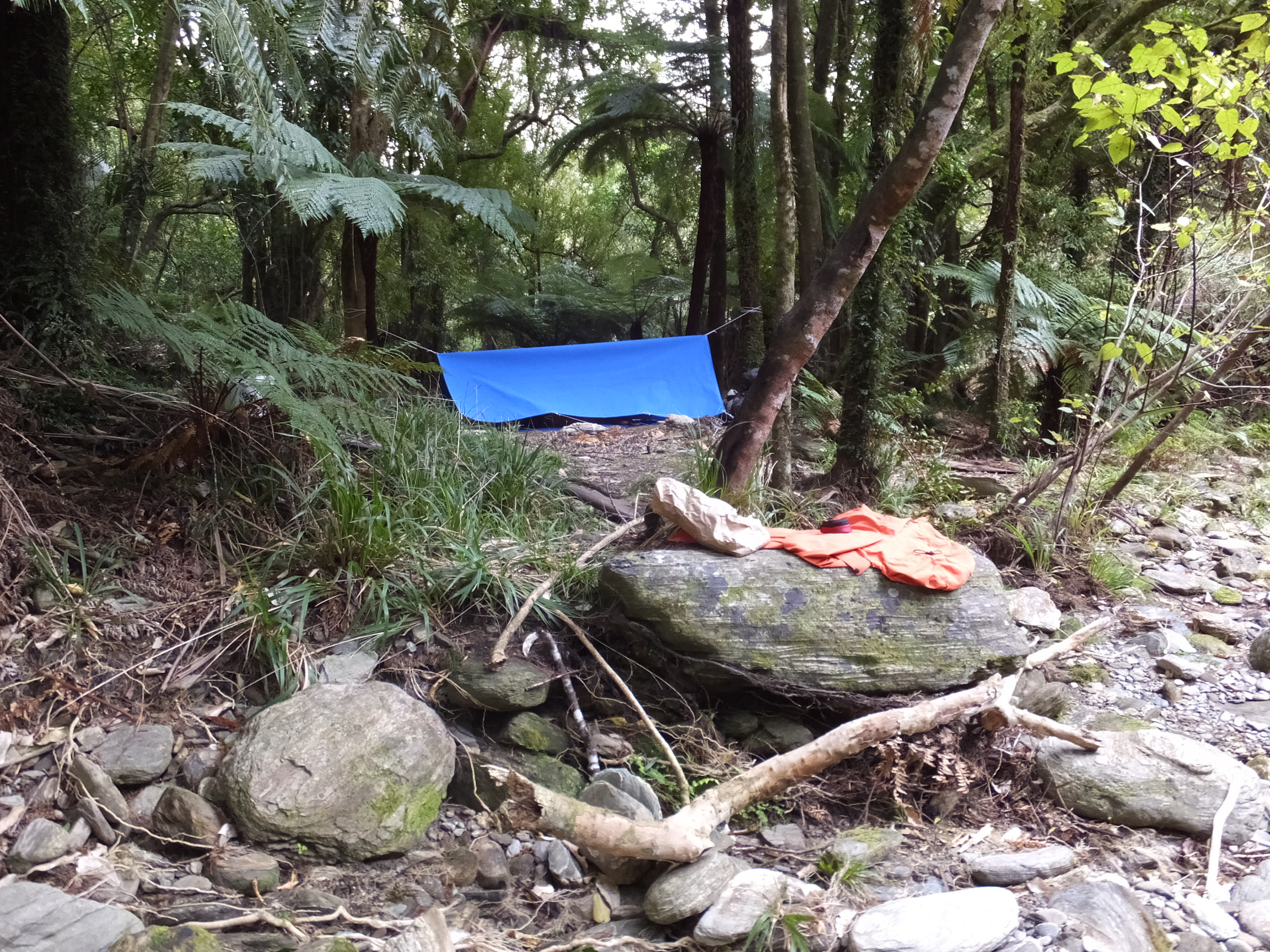 Part of the 21 day 'Classic' Outward Bound course that I did in 2014 involved a 3 day 'solo' - i.e. surviving by ourselves, with limited food and limited shelter for 3 nights. It is still something that I look back on today a a 'benchmark' of what I've accomplished. See that piece of blue material? That was my 'home' for 3 nights AND I LOVED IT!