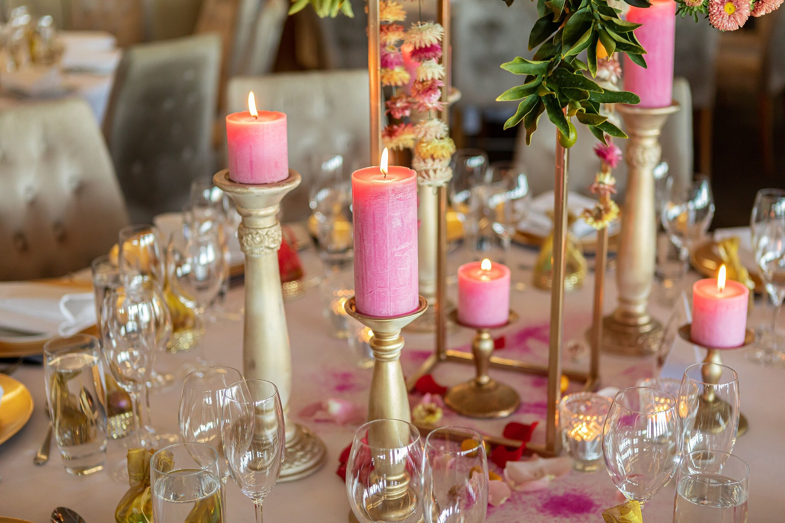 pink pillar candles gold accents