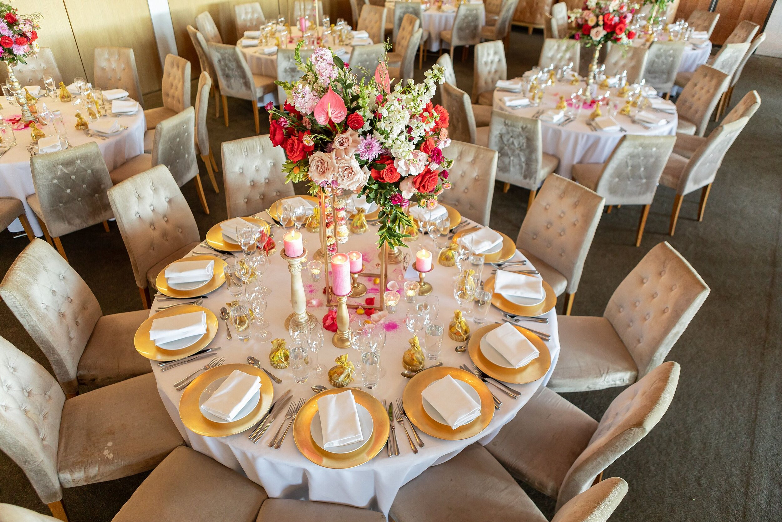 Table styling bold bright wedding flowers