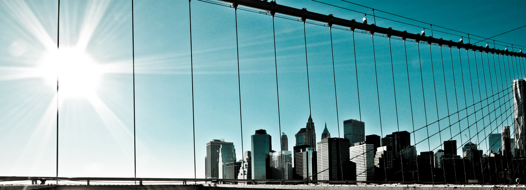 Manhattan Through the Bridge by Geraint Rowland