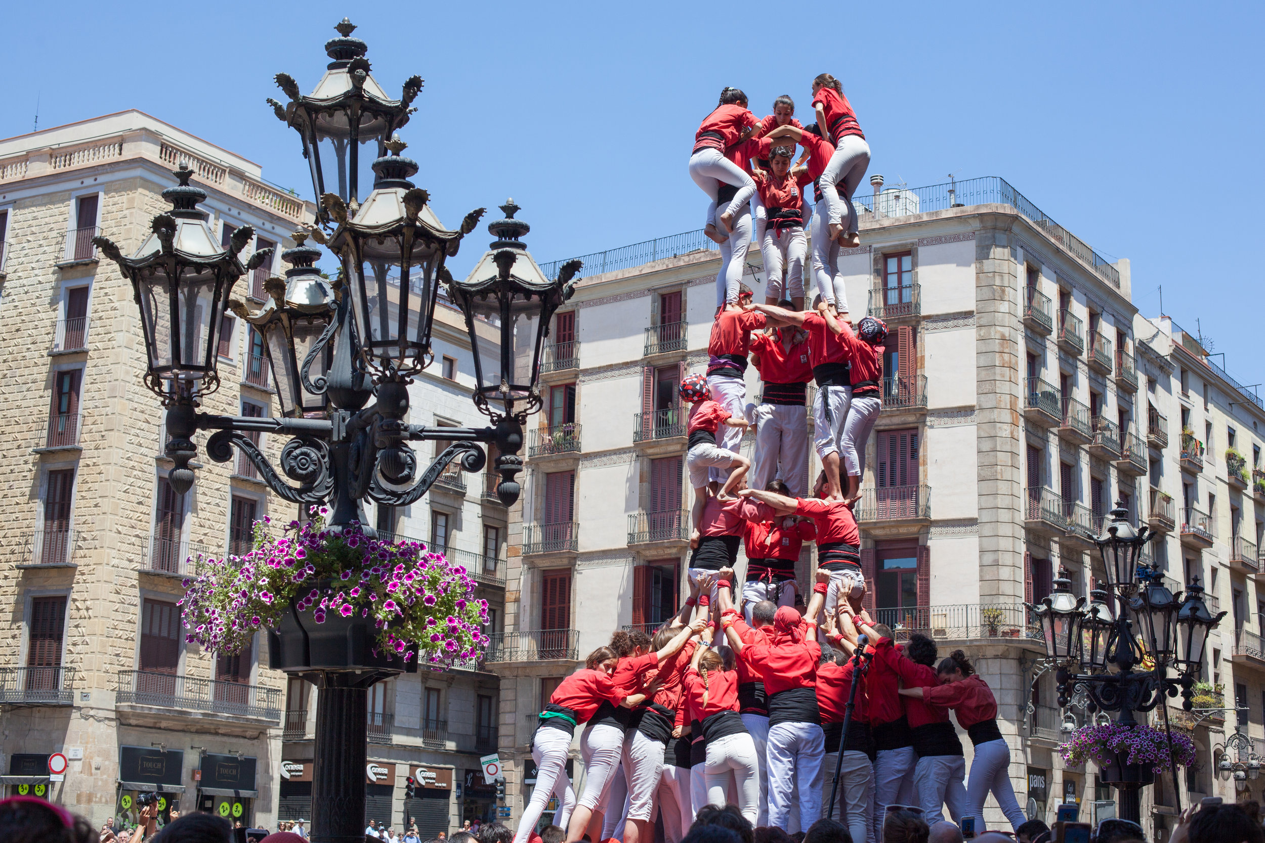 A   castell   (Catalan pronunciation:  [kəsˈteʎ] ) is a  human tower  built traditionally in festivals at many locations within  Catalonia