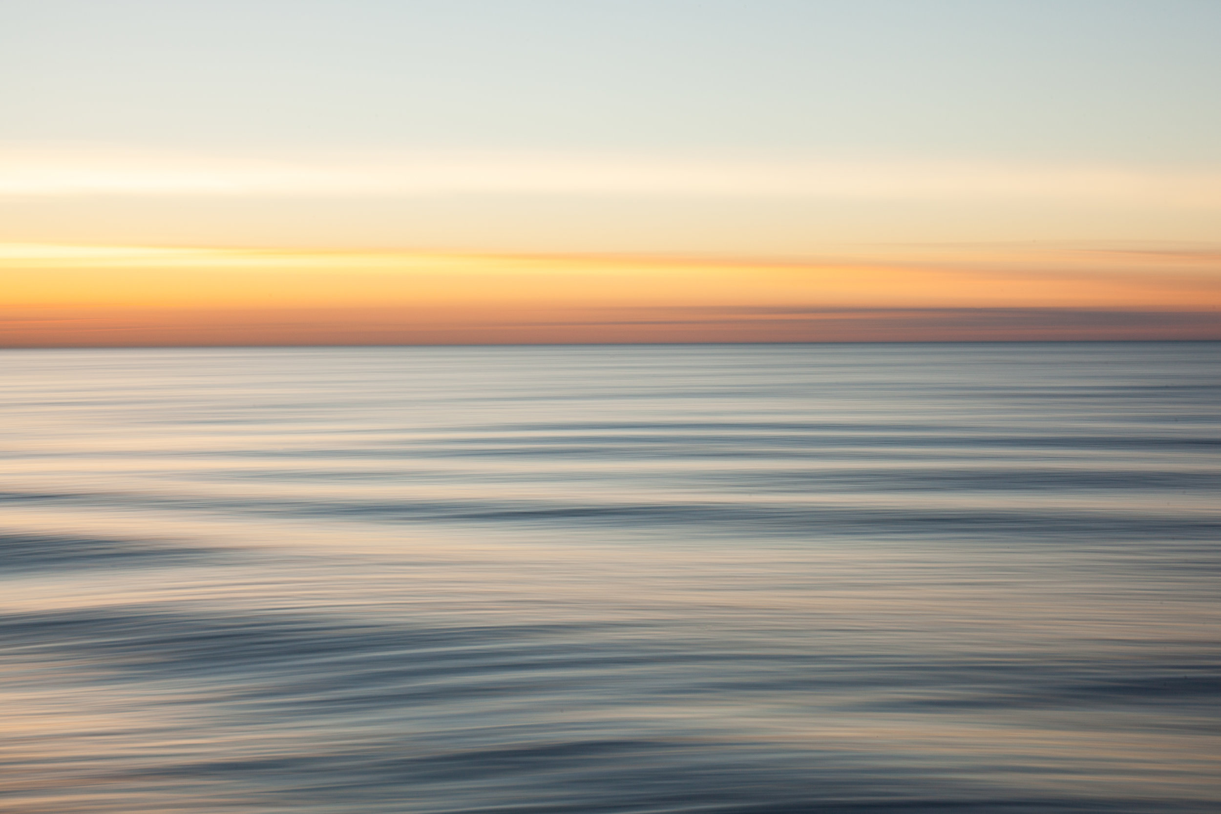 An abstract water photo at sunset by Geraint Rowland Photography.