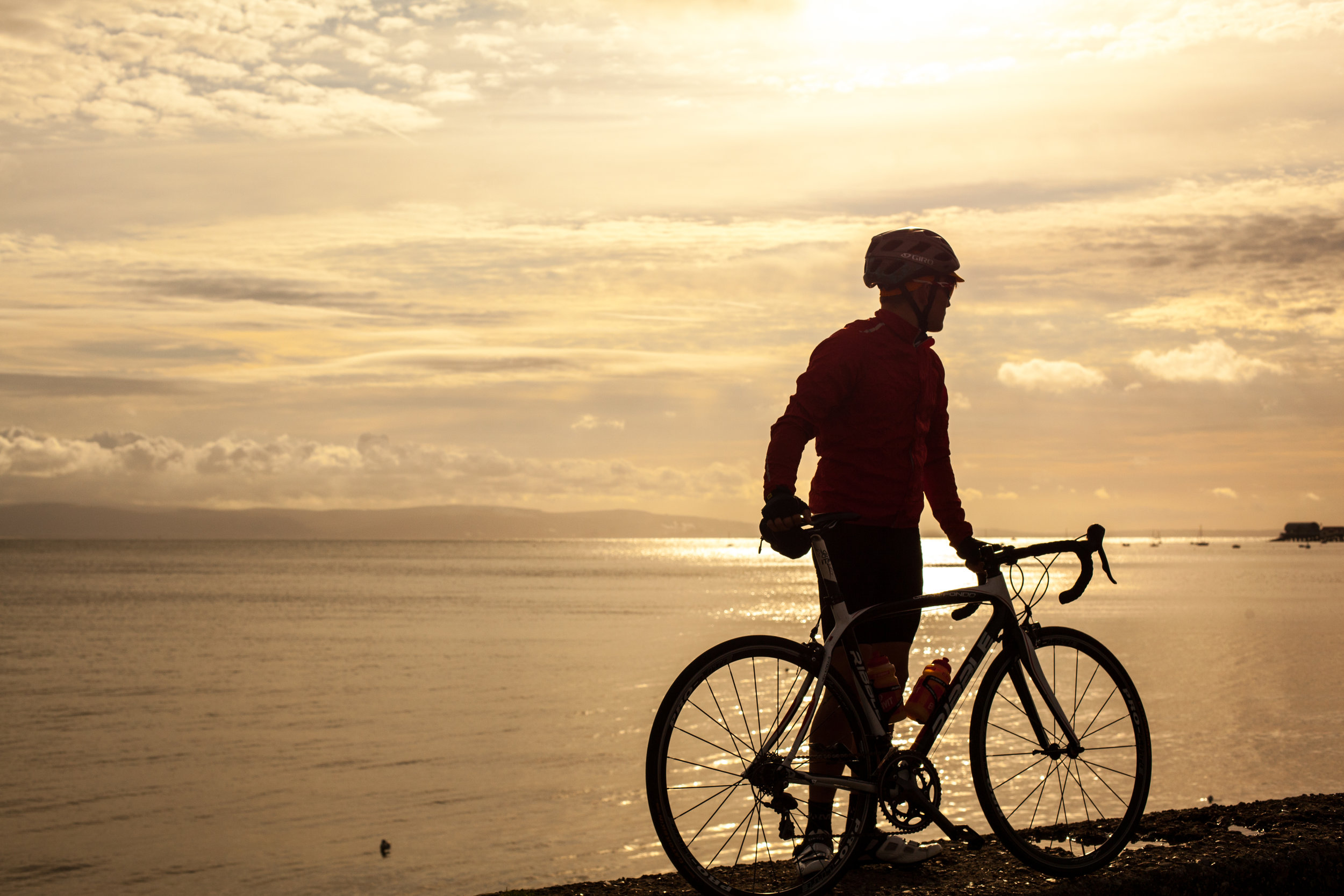 Welsh cyclist William Morgan at sun rise at the Mumbles in Swansea.
