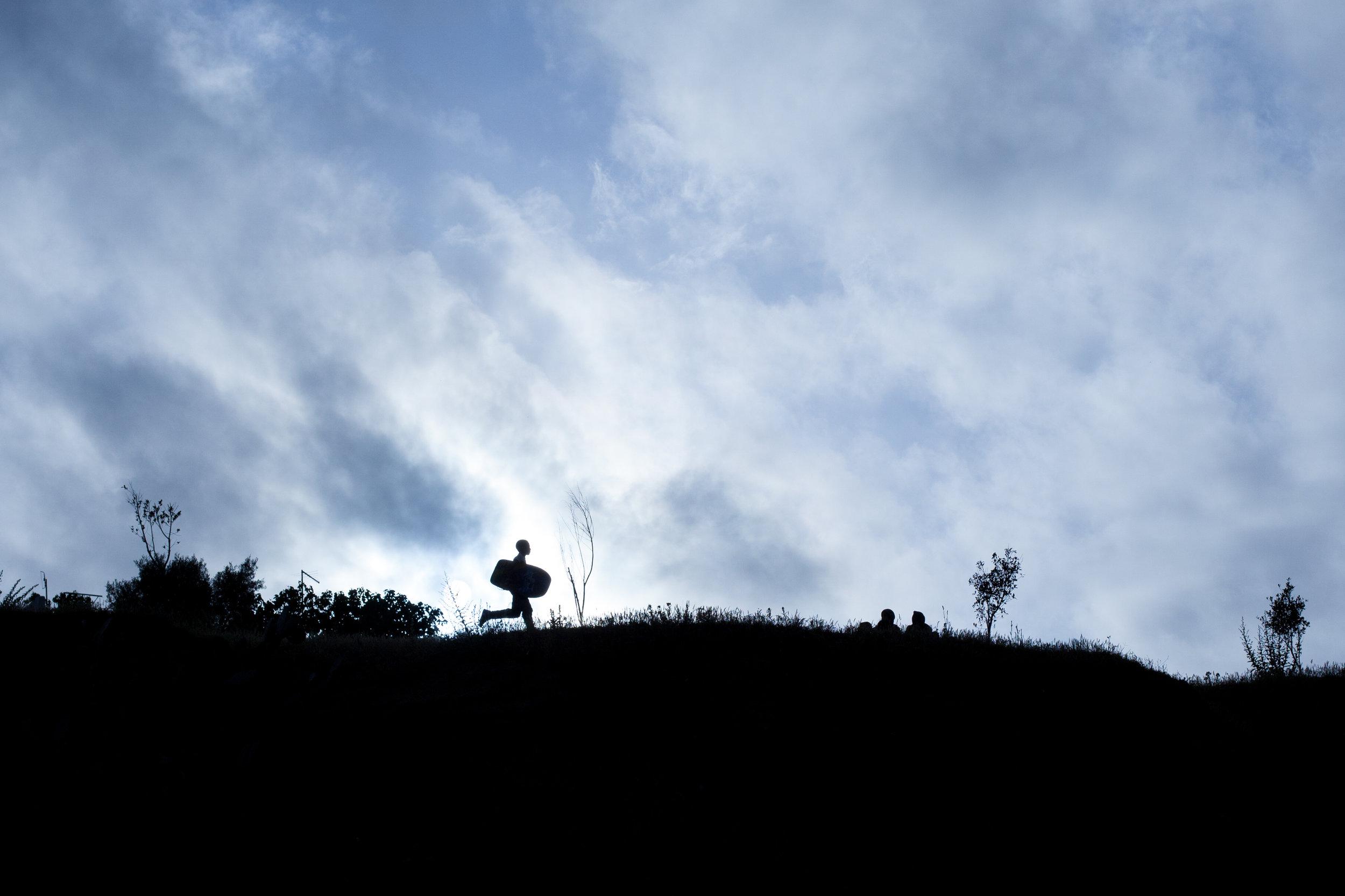 A silhouette photo of a body boarder in Morocco.
