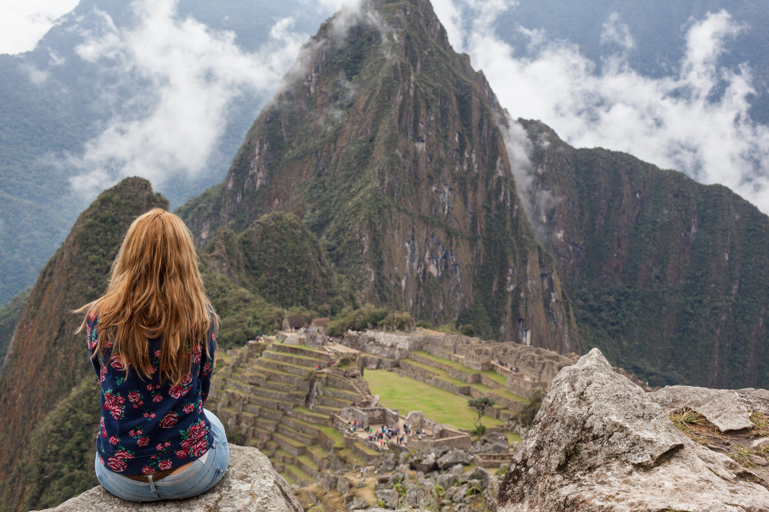 A solo female traveller enjoying Machu Picchu.