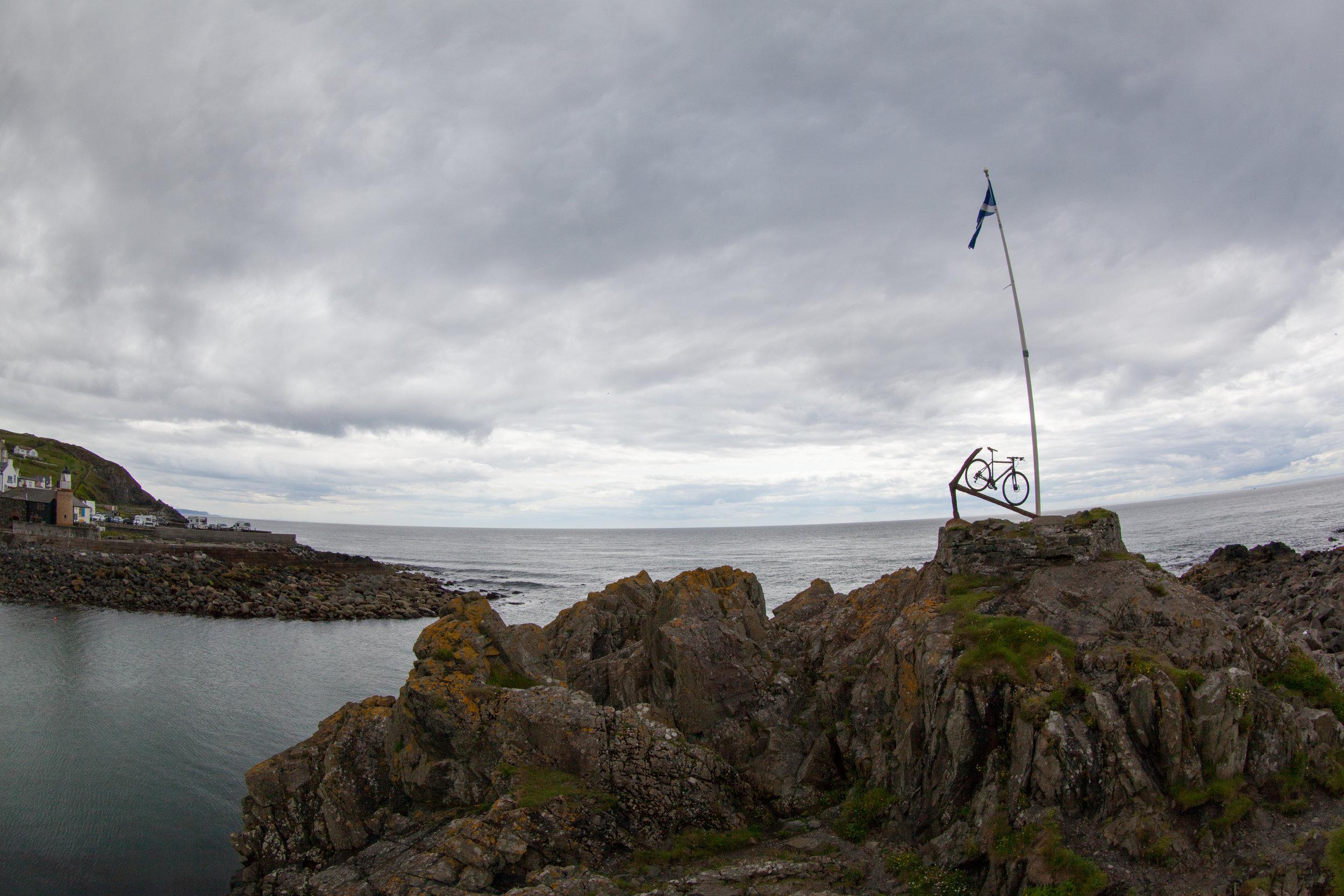 A rocky outcrop on the coastline of Scotland.