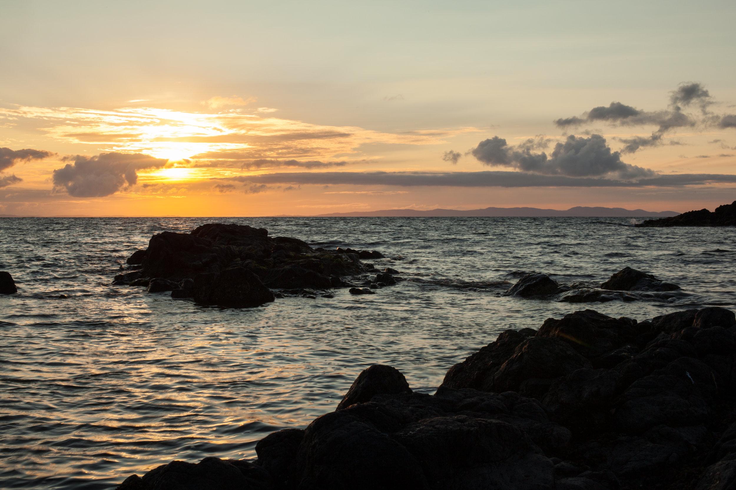 The sun setting somewhere in Scotland.