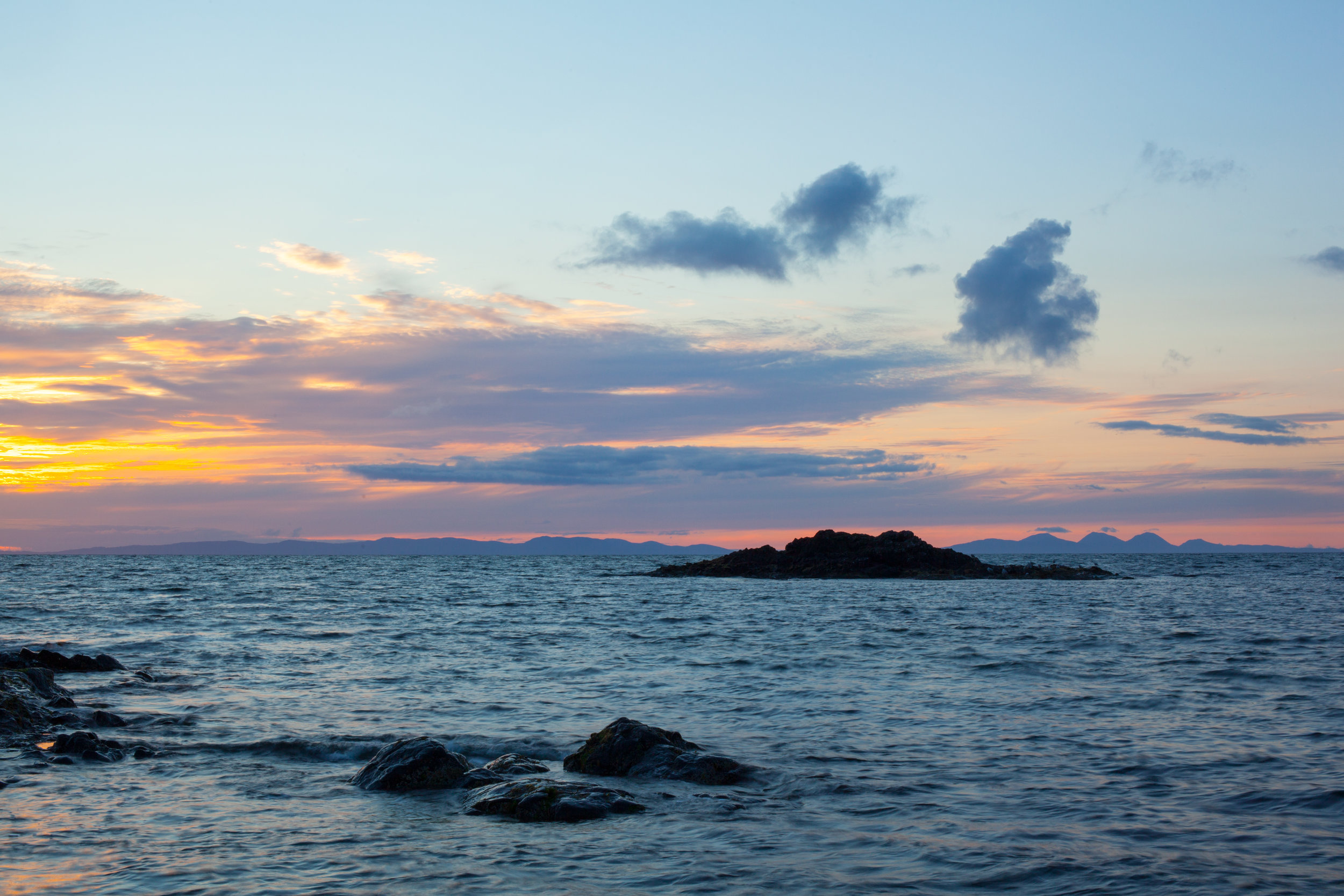 The coastline west of Campbeltown, Scotland during sunset.