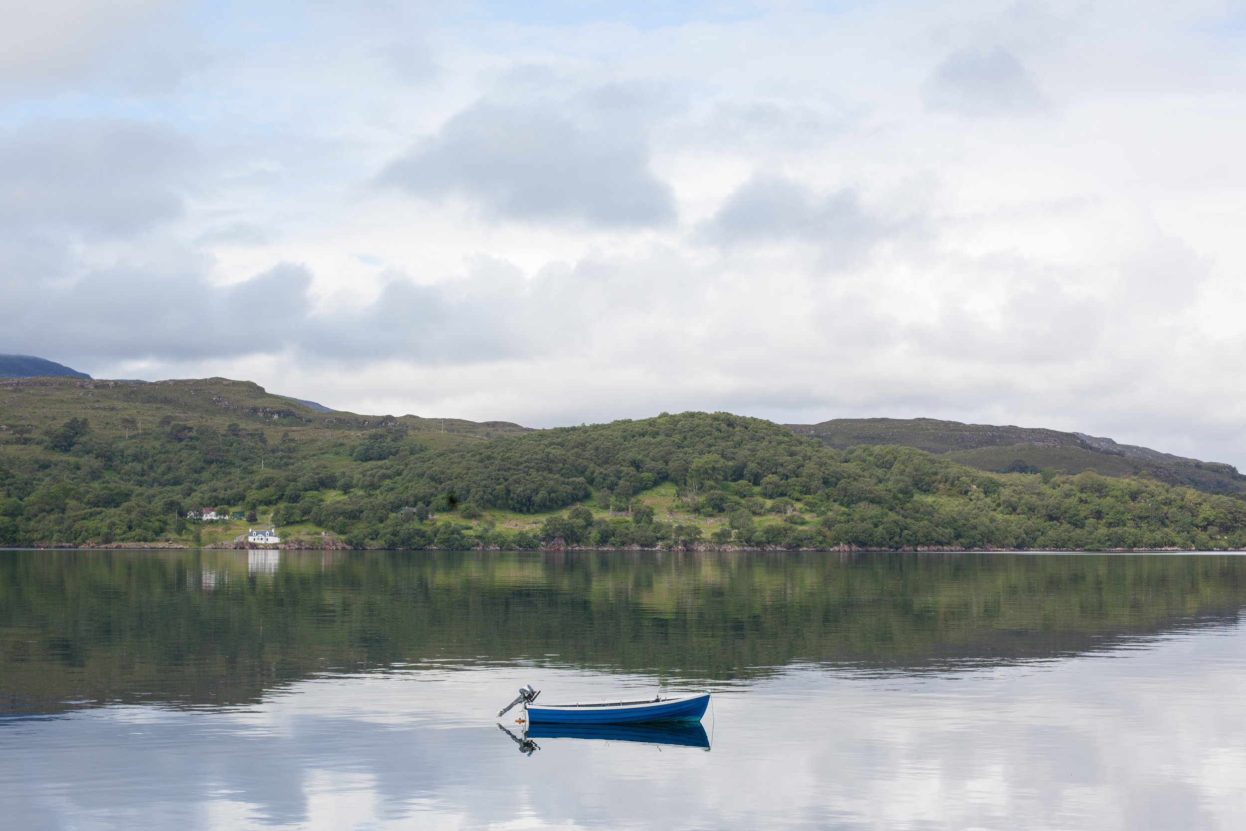 A small boat in this tranquil photo in Scotland.