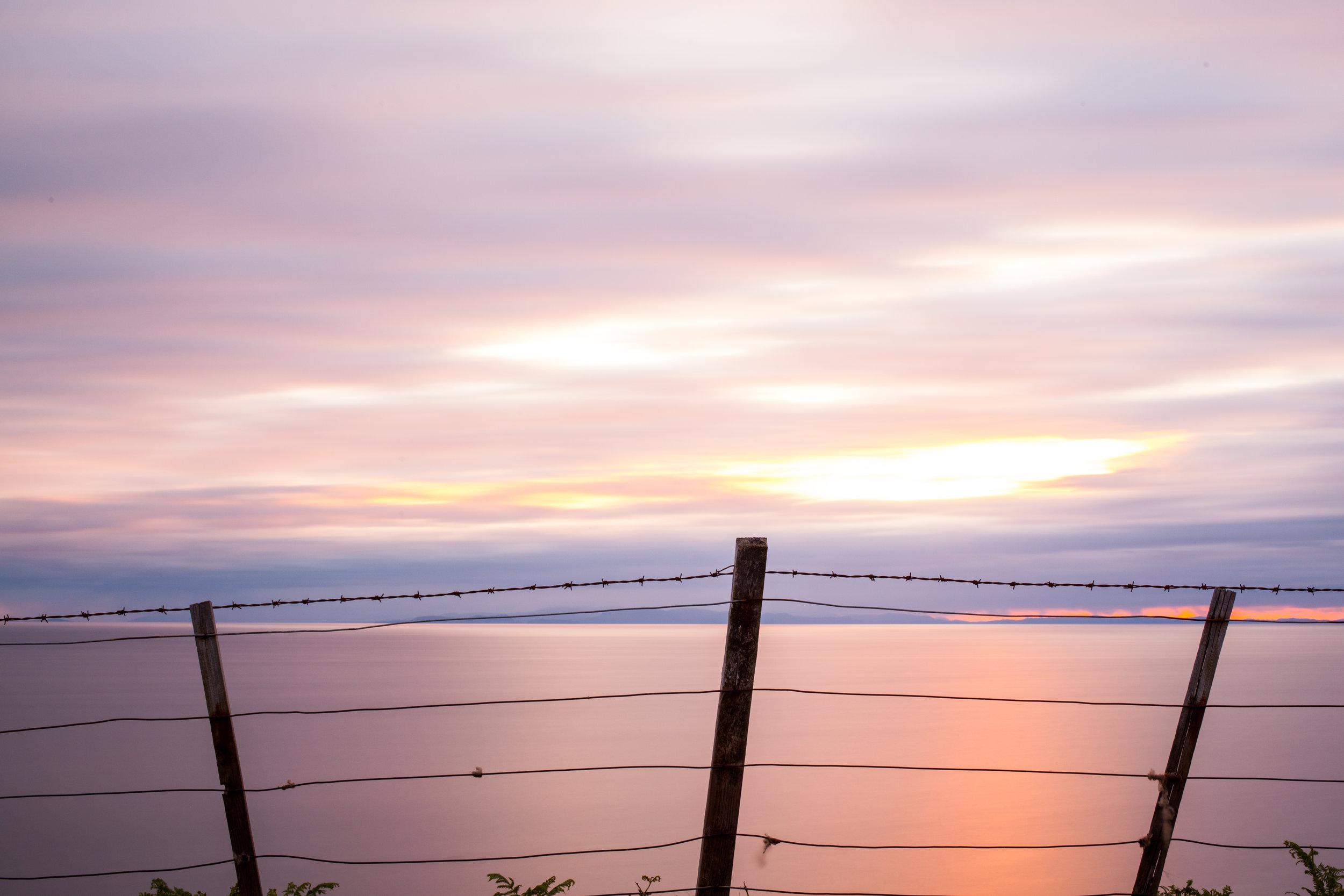 Sunset, Sea, barbed wire, Scotland.