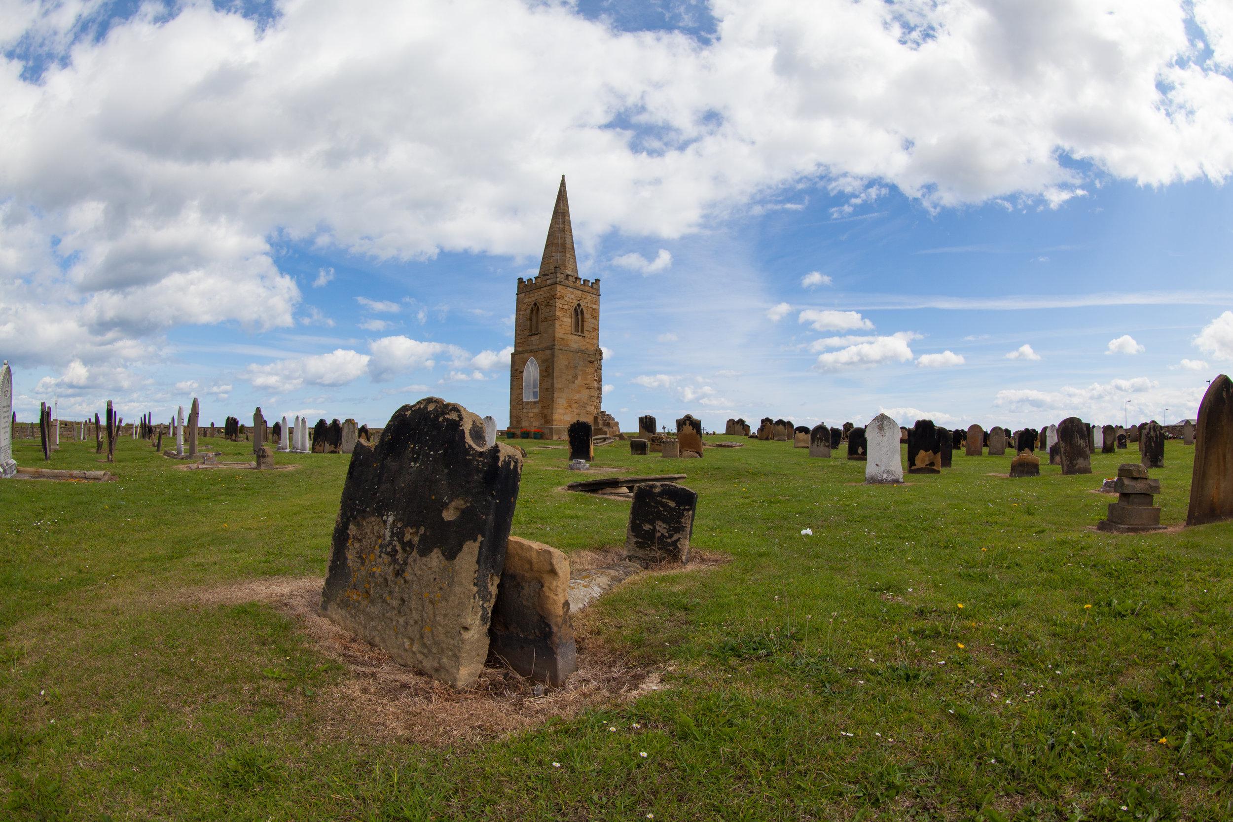 A church and graveyard.