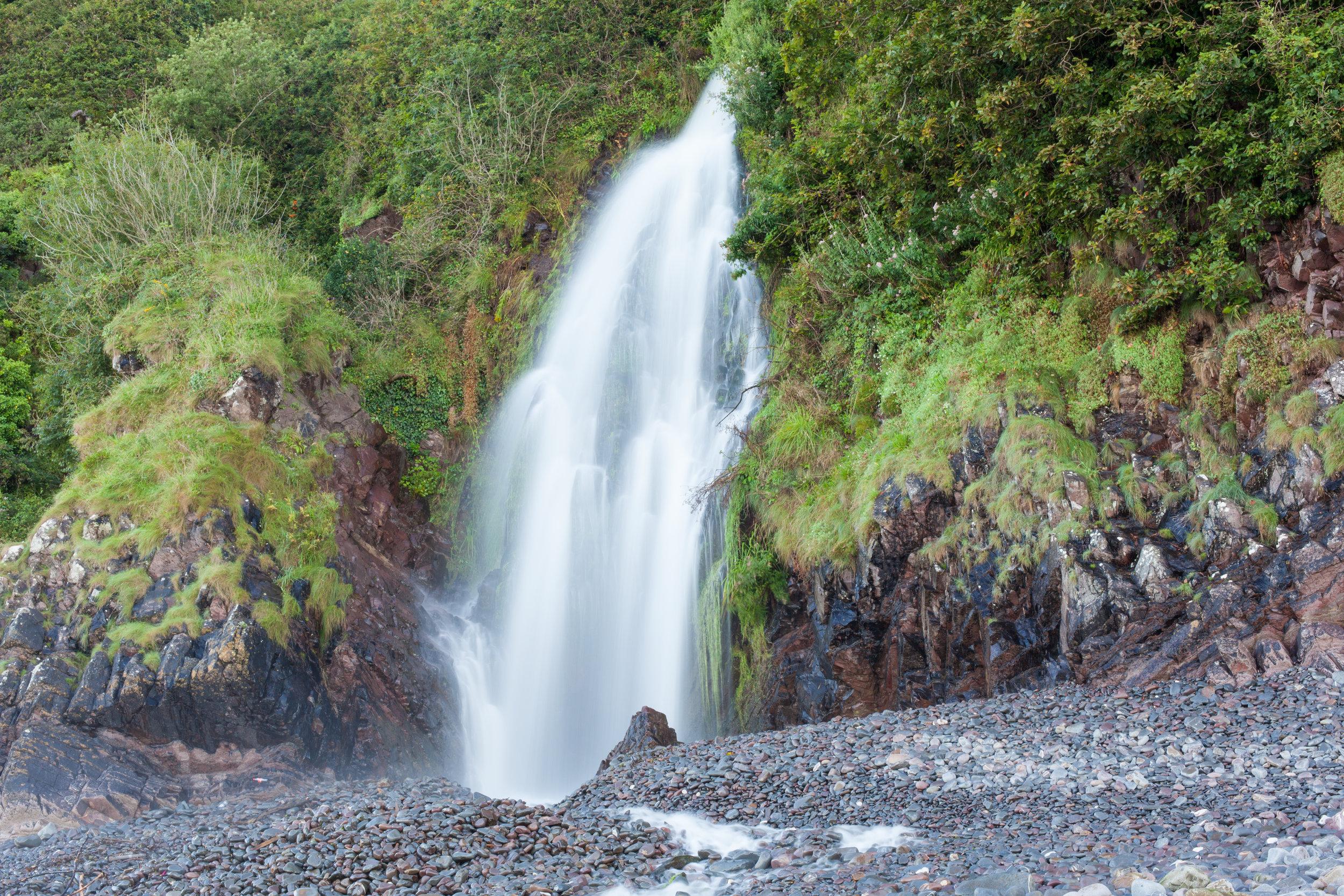 A waterfall at Clovelly Beach in Devon.